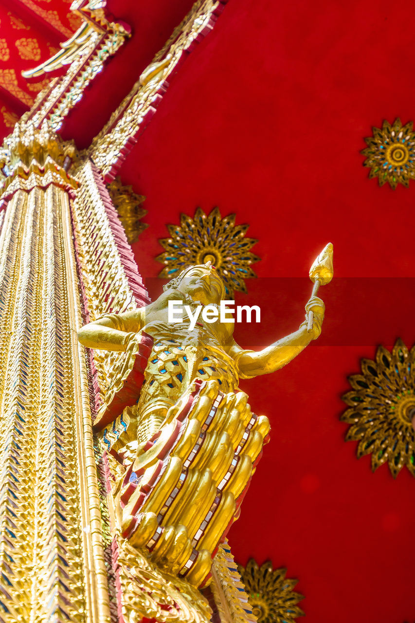 gold colored, statue, art and craft, sculpture, no people, red, gold, spirituality, close-up, crown, golden, indoors, day