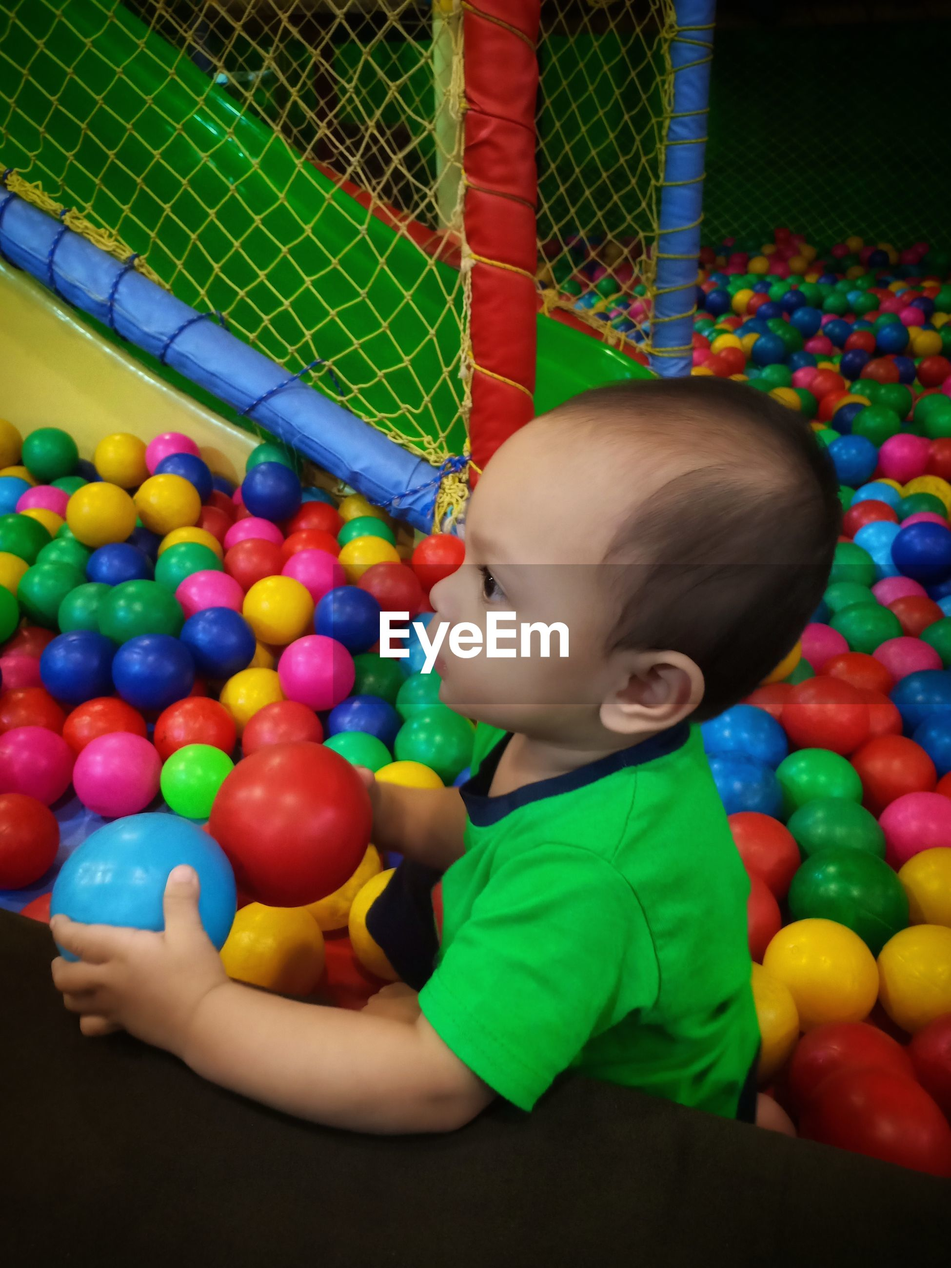 Cute baby boy playing in ball pool