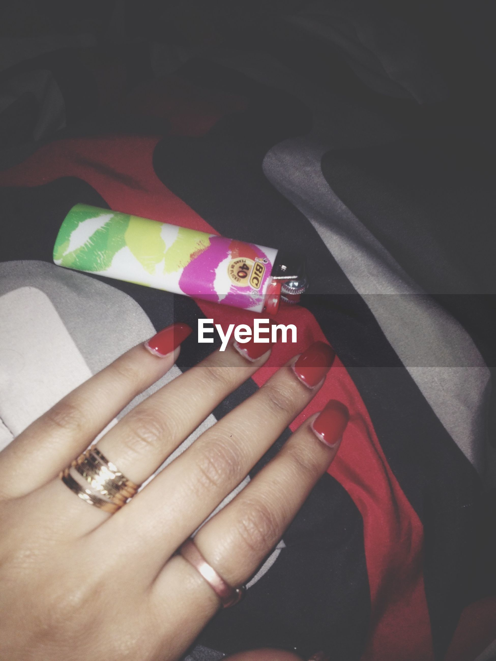 person, part of, indoors, personal perspective, cropped, holding, human finger, unrecognizable person, close-up, high angle view, lifestyles, low section, leisure activity, multi colored, nail polish
