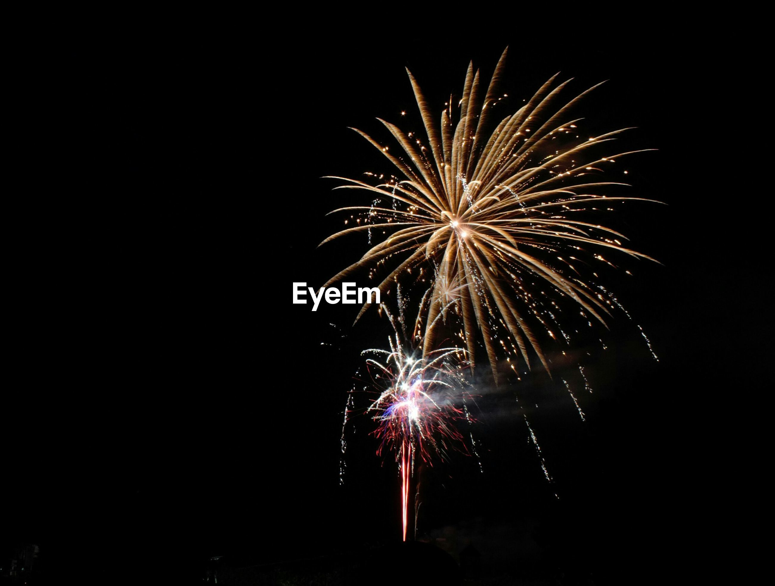 firework display, night, exploding, celebration, long exposure, firework - man made object, illuminated, motion, event, glowing, sparks, firework, arts culture and entertainment, blurred motion, entertainment, low angle view, sky, celebration event, fire - natural phenomenon, multi colored