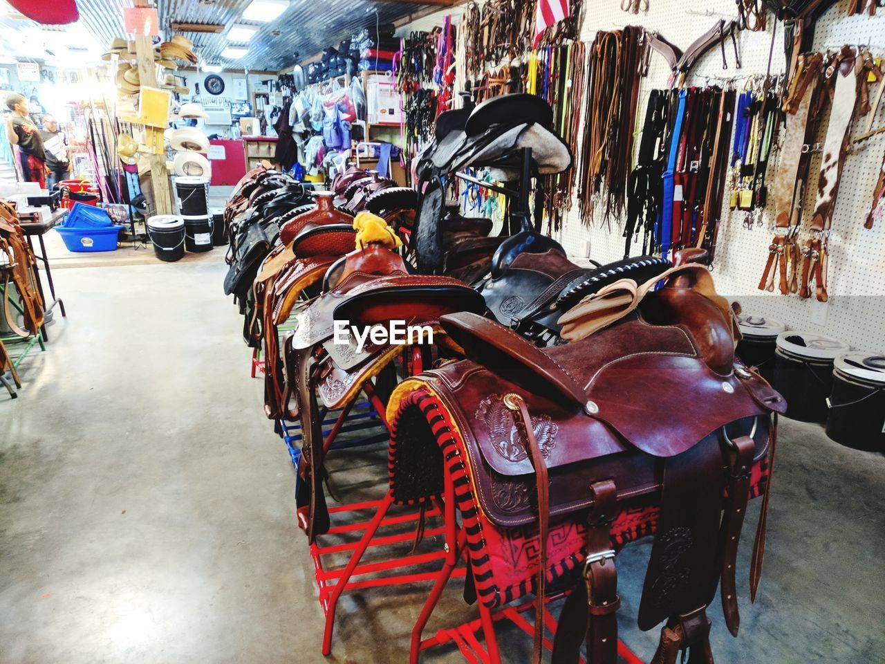 transportation, mode of transportation, city, incidental people, architecture, travel, day, outdoors, focus on foreground, street, built structure, in a row, bicycle, people, market, large group of objects, building exterior, land vehicle, choice