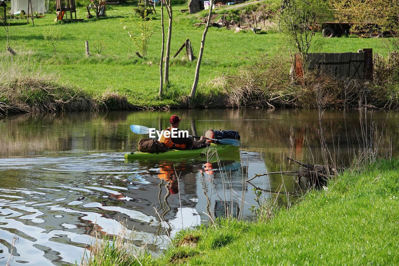 Men kayaking in lake