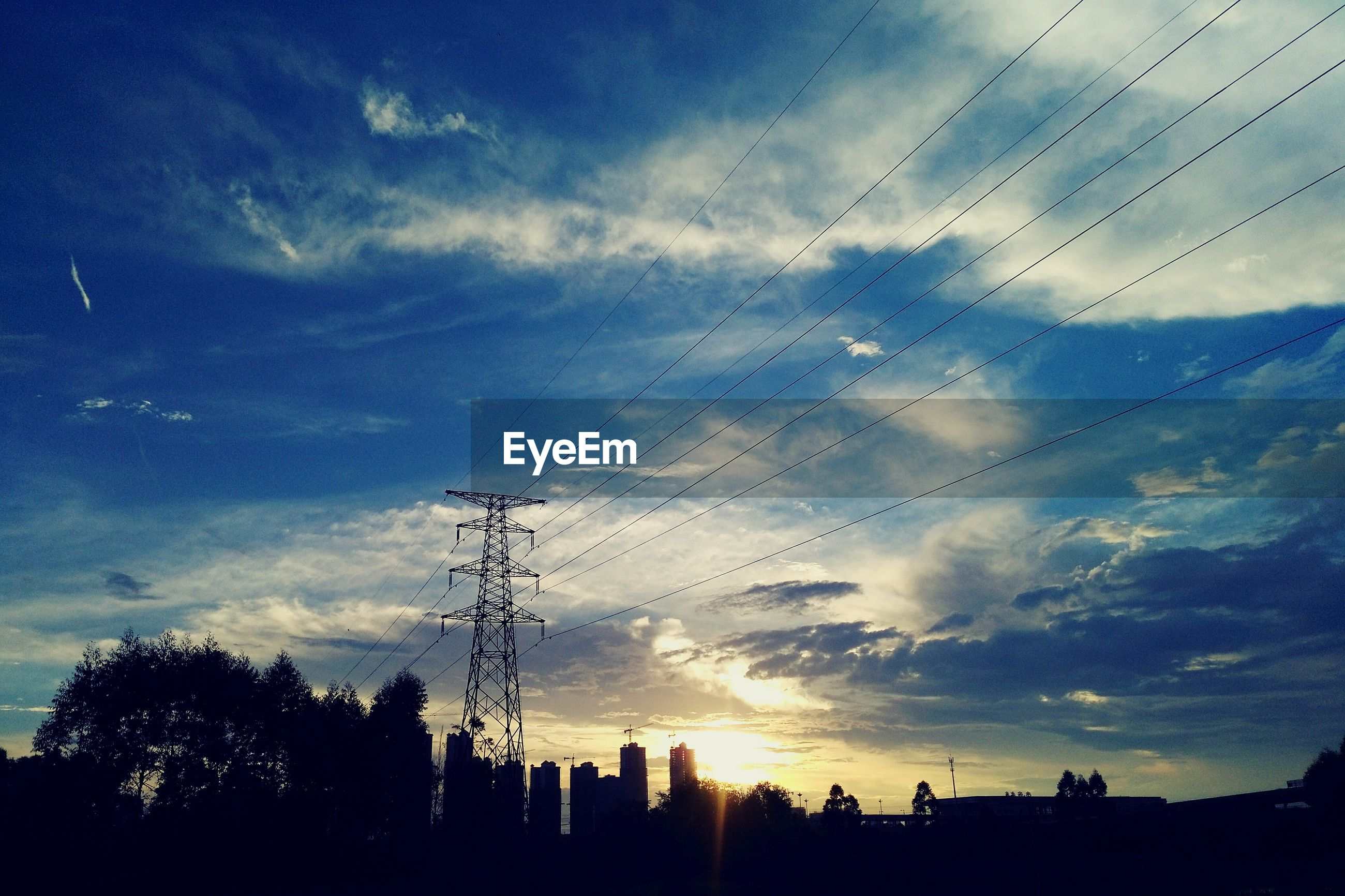 silhouette, sky, low angle view, cloud - sky, sunset, cloud, cloudy, power line, nature, beauty in nature, no people, outdoors, blue, outline, scenics, tranquility, tranquil scene