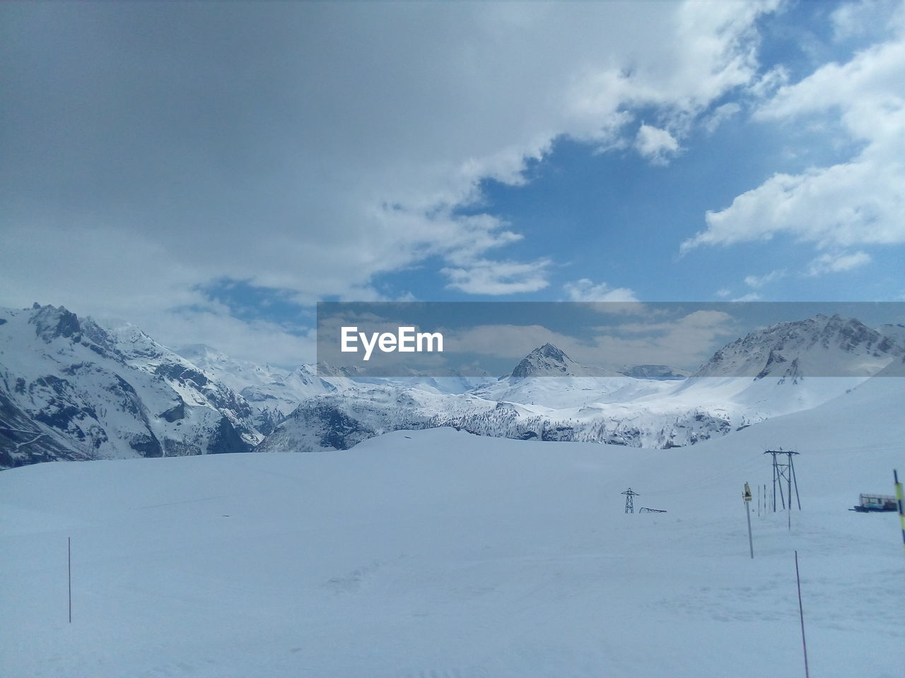 snow, winter, cold temperature, weather, white color, nature, tranquility, beauty in nature, landscape, scenics, tranquil scene, mountain, sky, outdoors, cloud - sky, day, snowcapped mountain, no people, ski lift