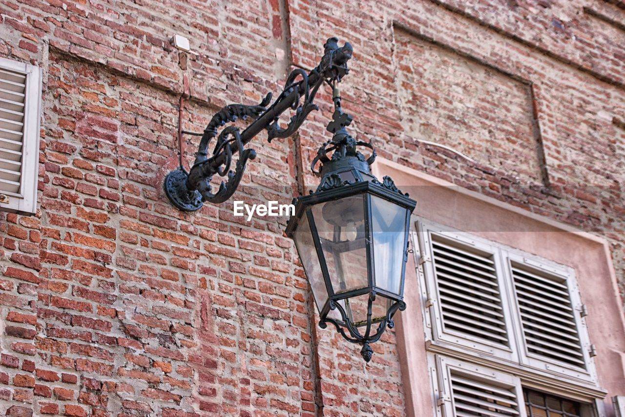 architecture, wall, building exterior, brick wall, brick, built structure, low angle view, lighting equipment, wall - building feature, street light, window, no people, day, outdoors, building, technology, street, electric lamp, old, nature, light