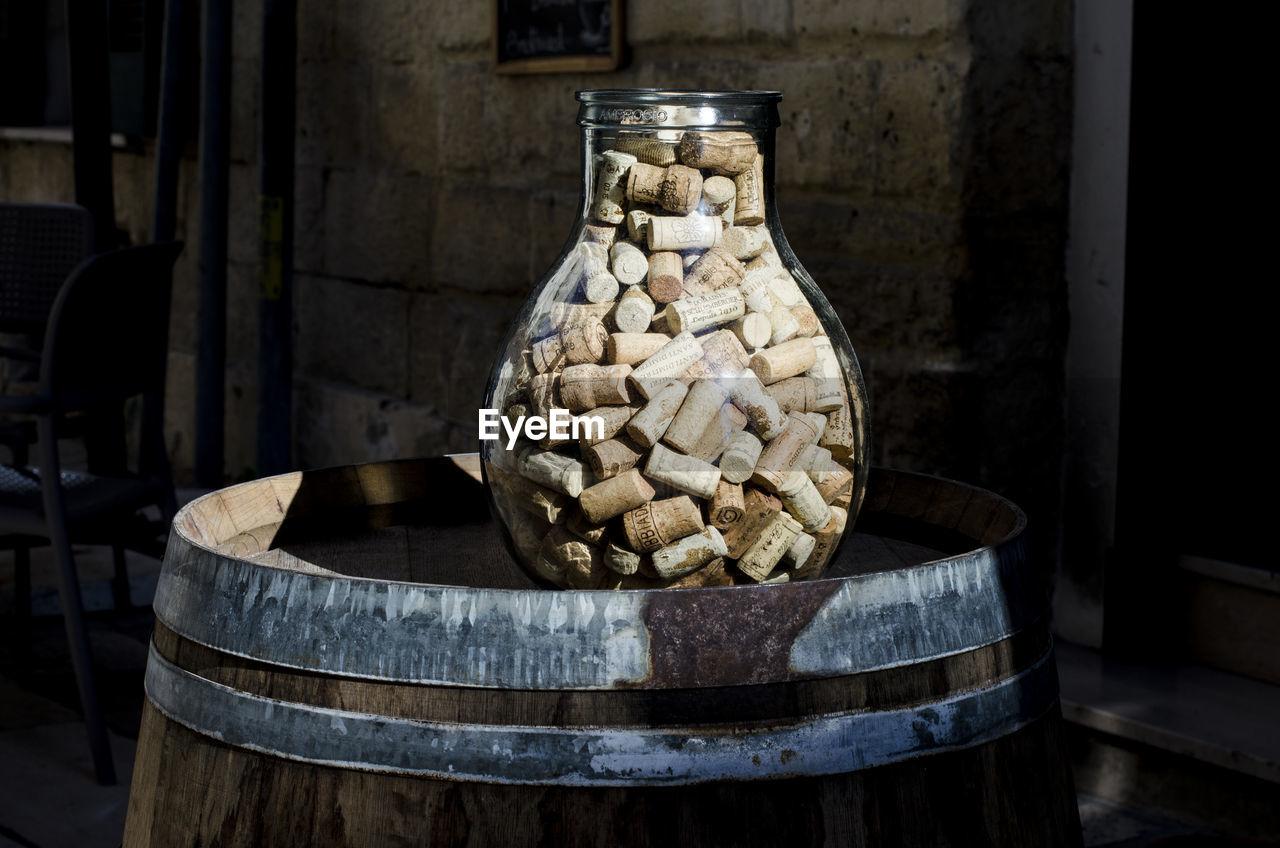 Corks In Jar On Barrel