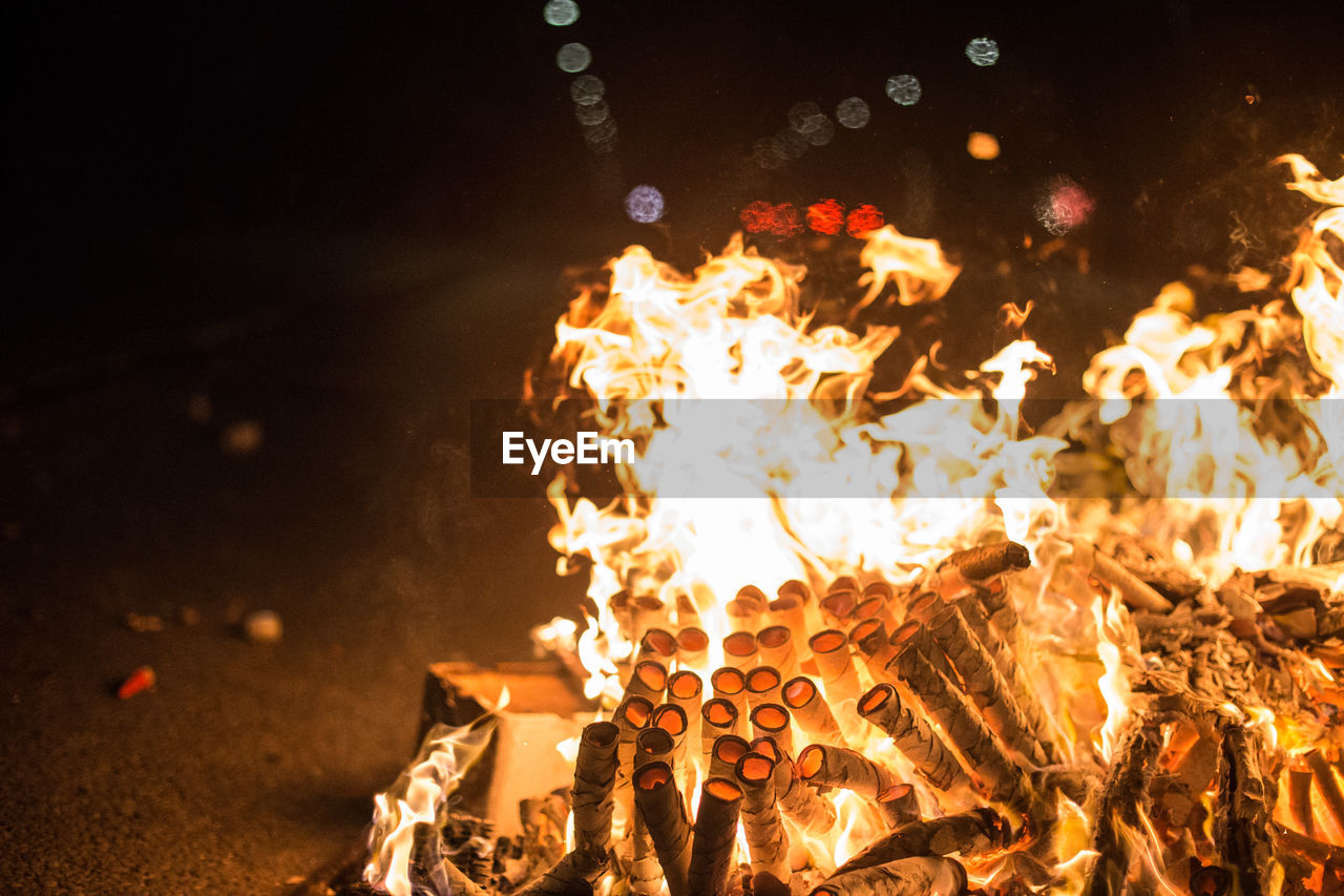 Close-up of bonfire on fire at night