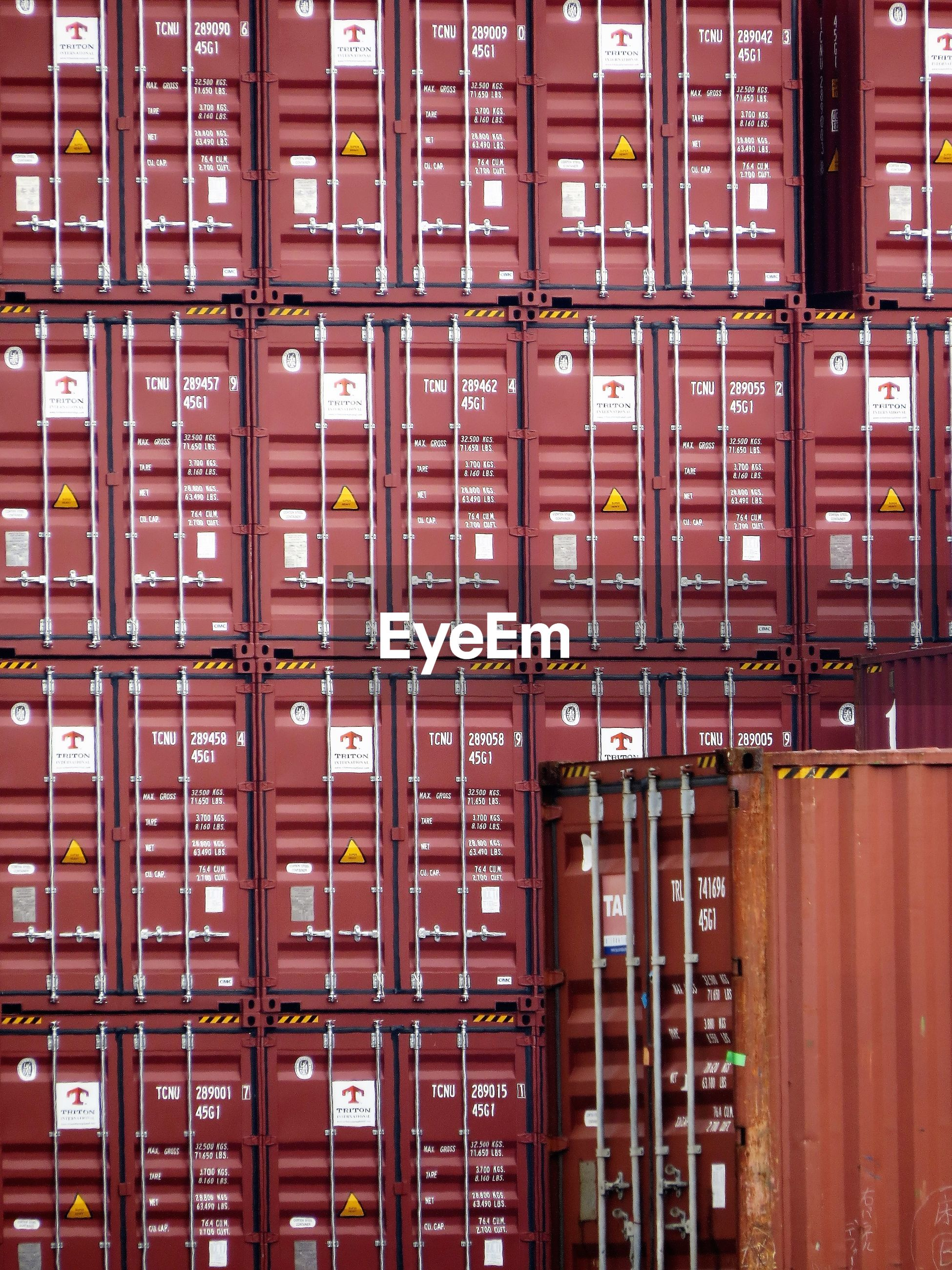 Full frame shot of containers at shipping yard