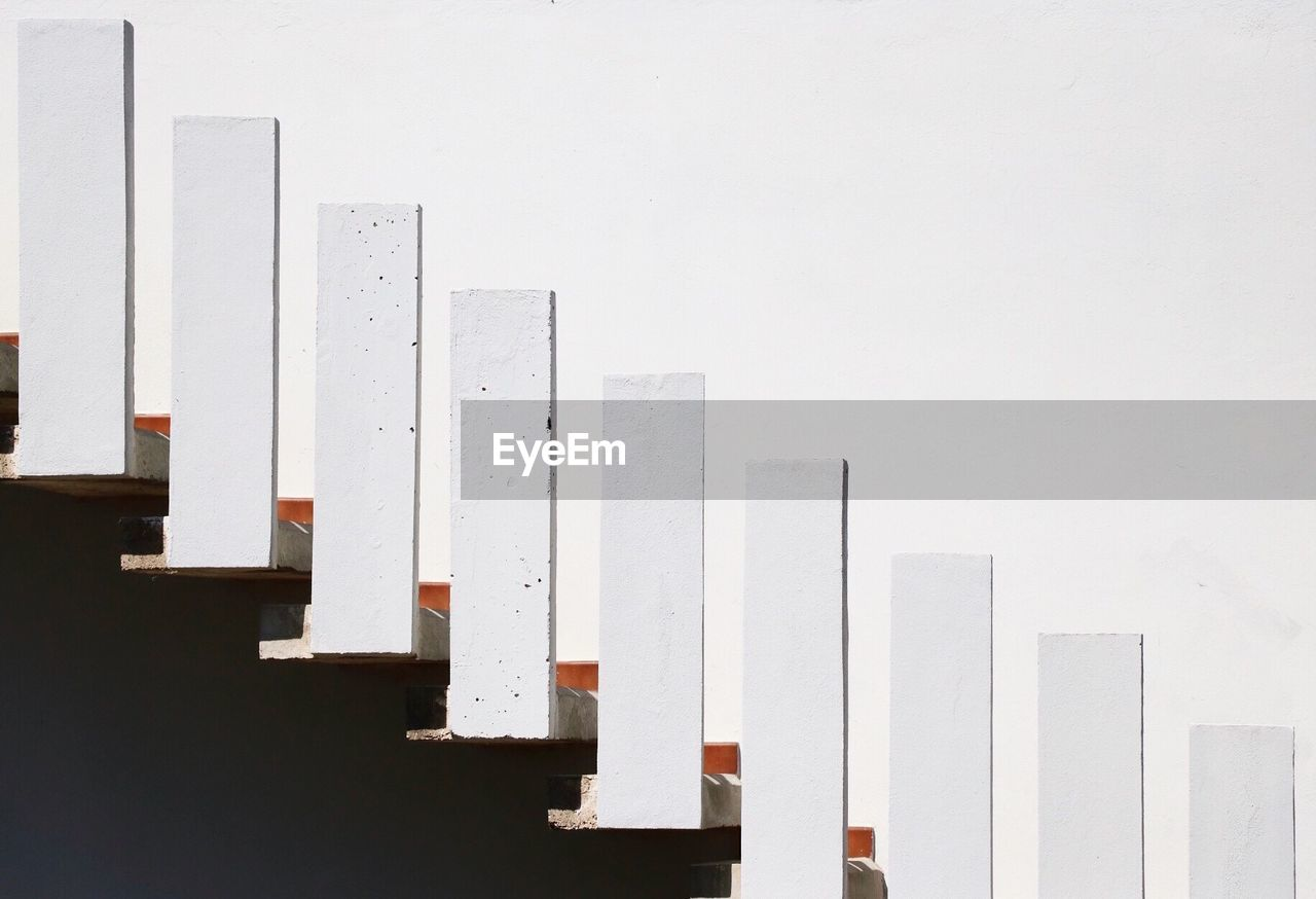 no people, copy space, architecture, white color, built structure, indoors, wall - building feature, wood - material, in a row, studio shot, white background, table, close-up, still life, group of objects, art and craft, red, day, white, blank