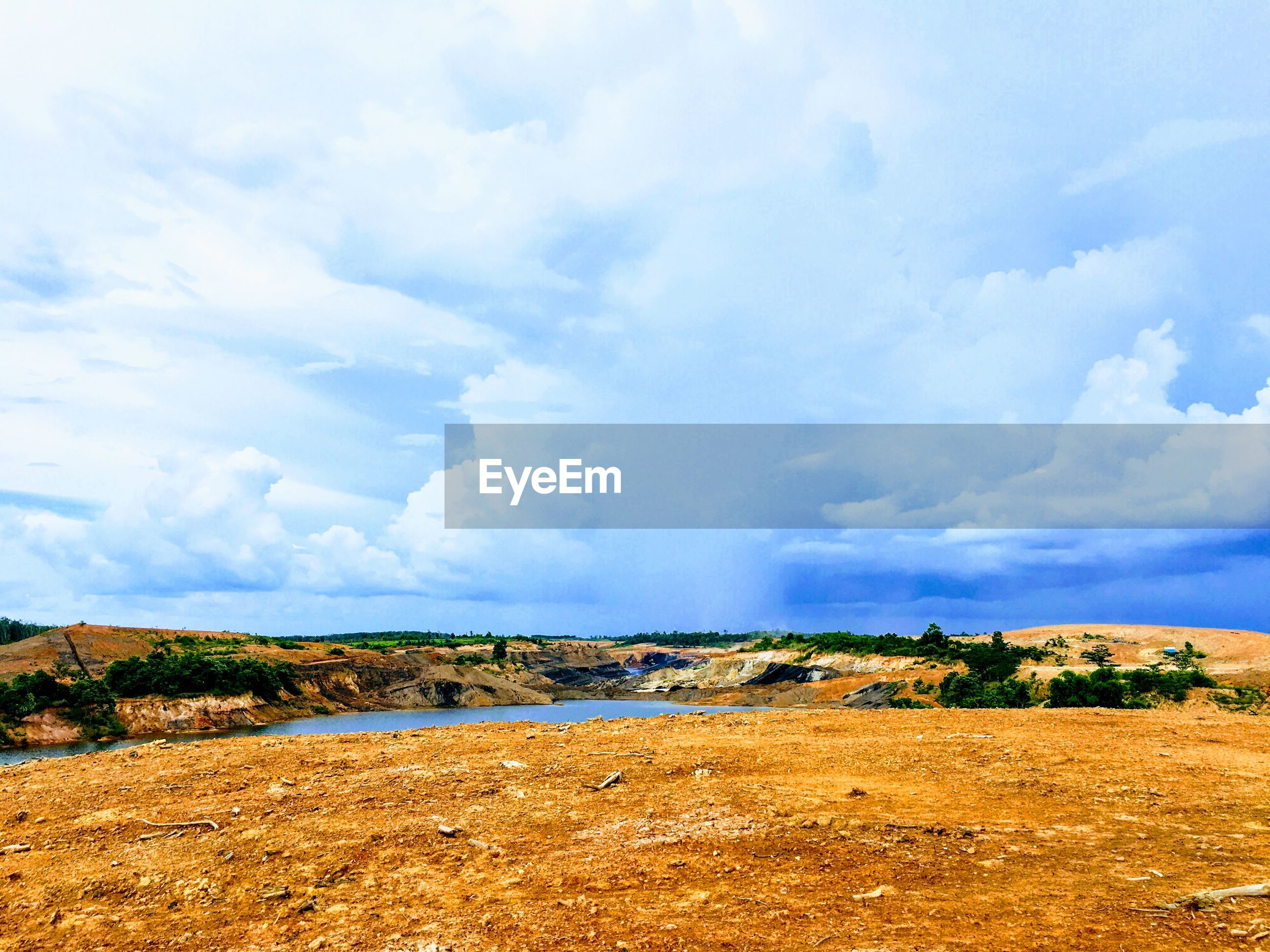 View of landscape against cloudy sky