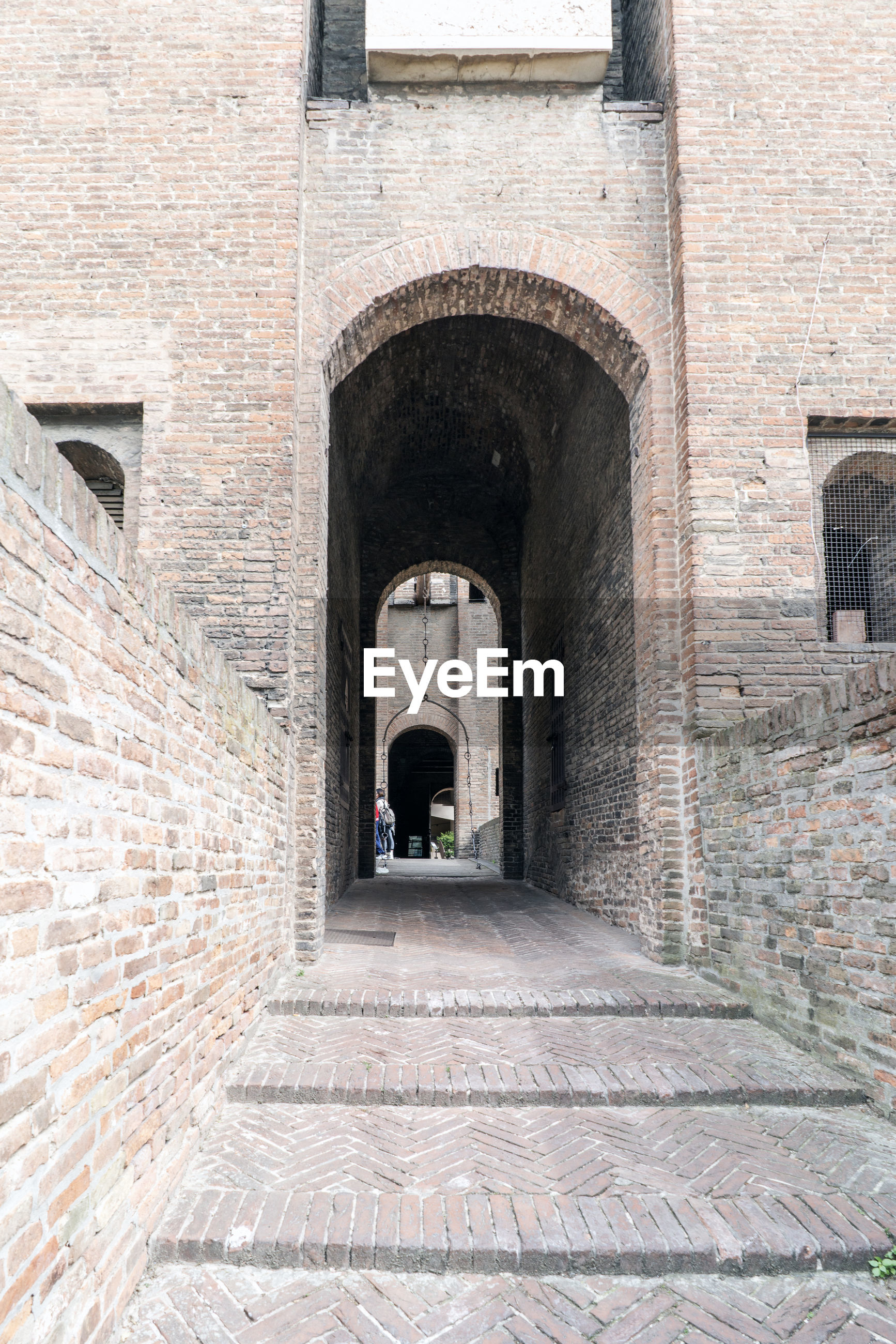MAN WALKING IN HISTORICAL BUILDING