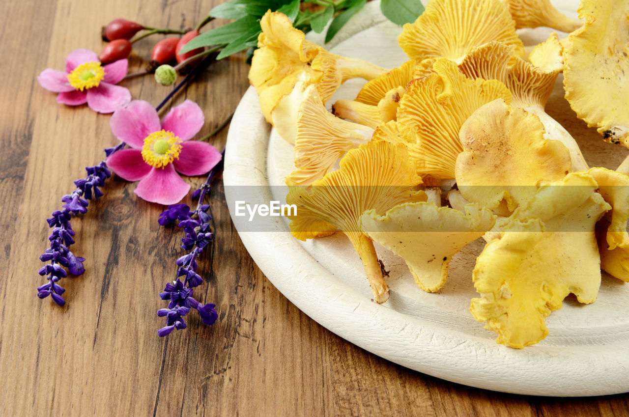 food, food and drink, high angle view, sweet food, table, no people, indoors, yellow, freshness, fruit, flower, studio shot, close-up, healthy eating, ready-to-eat, day