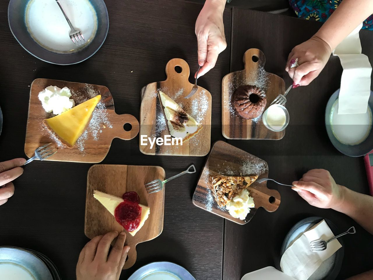 human hand, real people, hand, human body part, food and drink, food, group of people, holding, lifestyles, table, indoors, women, adult, people, high angle view, freshness, body part, togetherness, friendship, men, glass, finger, preparation, temptation