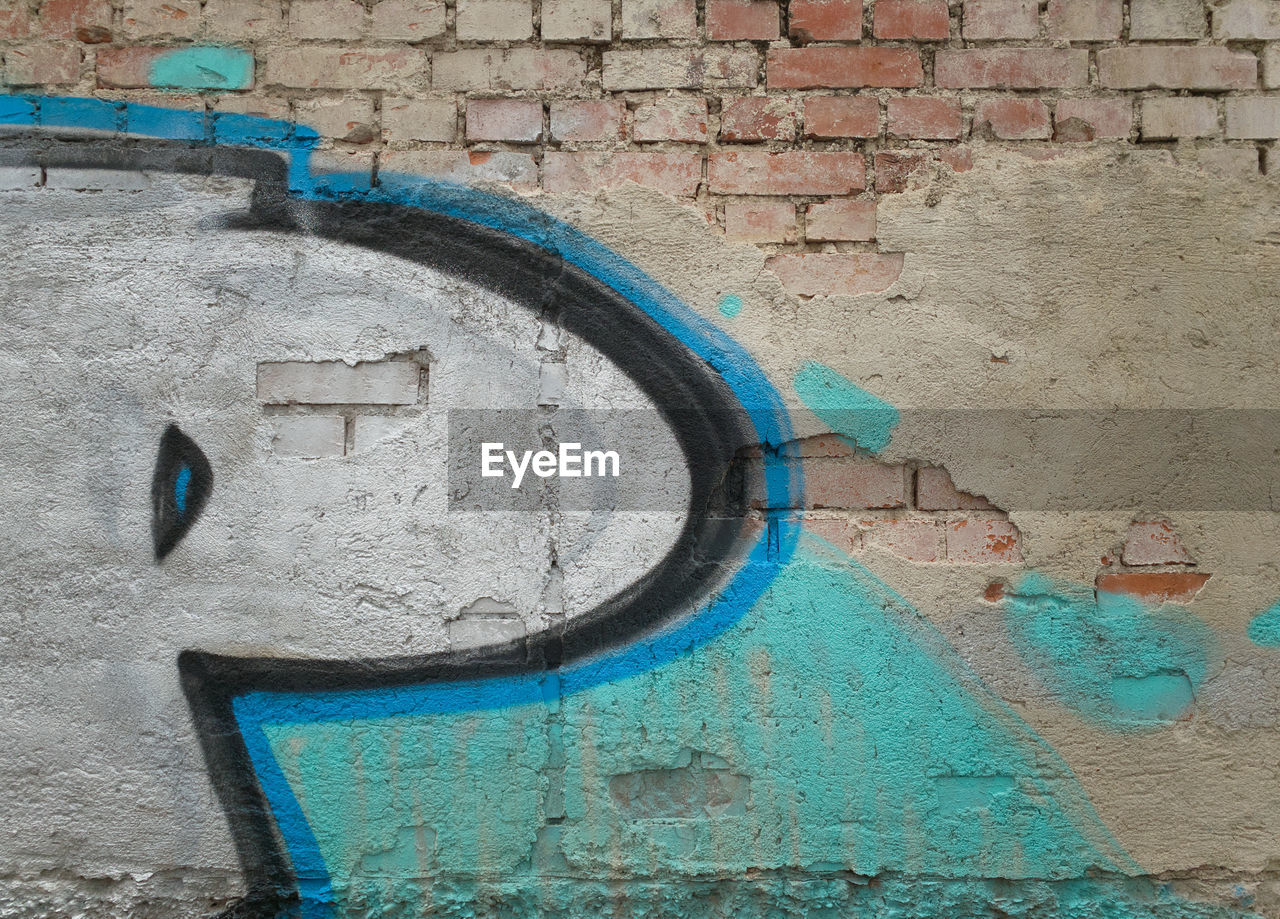 wall - building feature, wall, built structure, architecture, brick wall, brick, no people, day, building exterior, graffiti, old, weathered, textured, paint, metal, outdoors, close-up, blue, number, art and craft