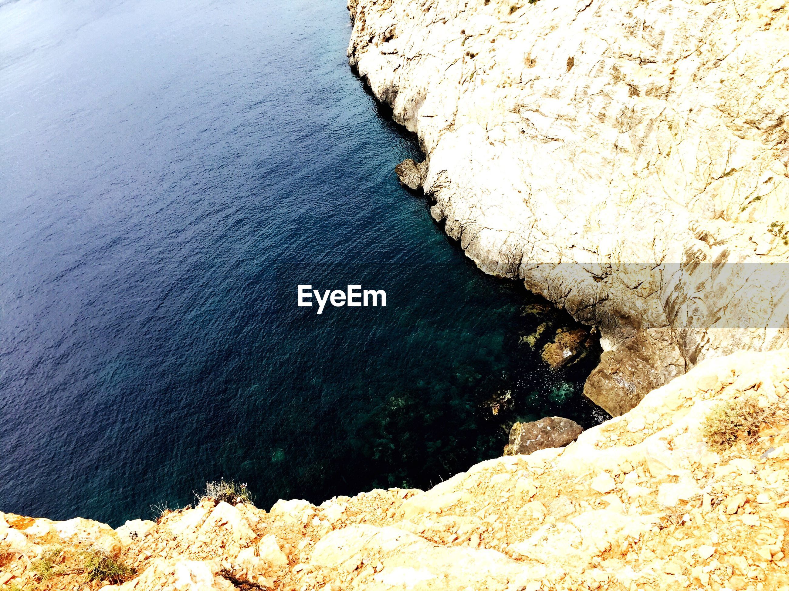 water, rock - object, high angle view, nature, beauty in nature, no people, day, sea, scenics, outdoors, close-up