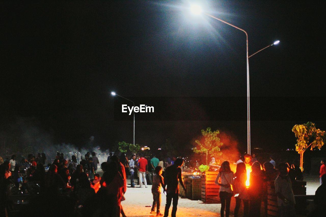 People enjoying on street at night