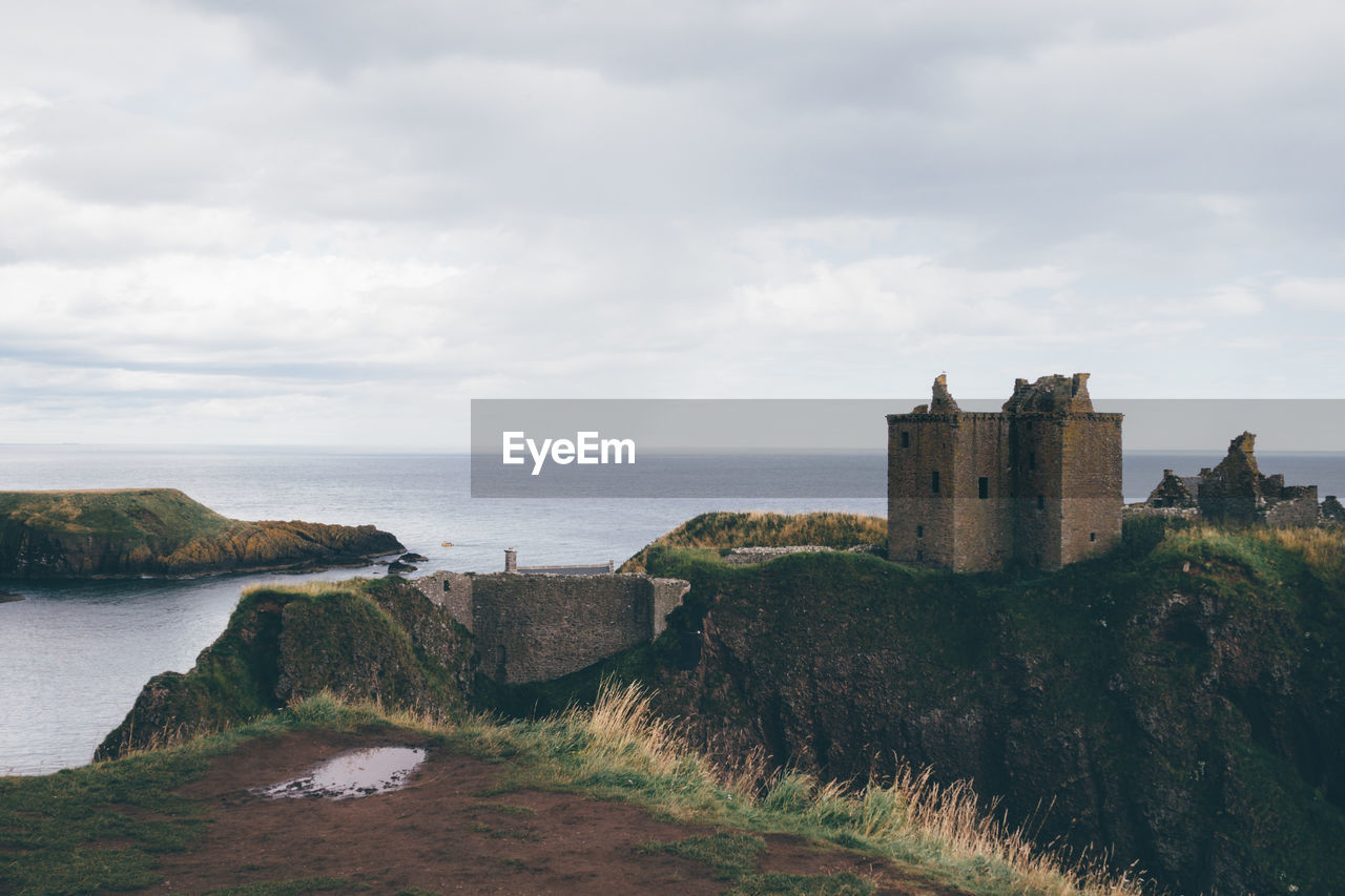 Dunnottar Castle By Sea Against Sky