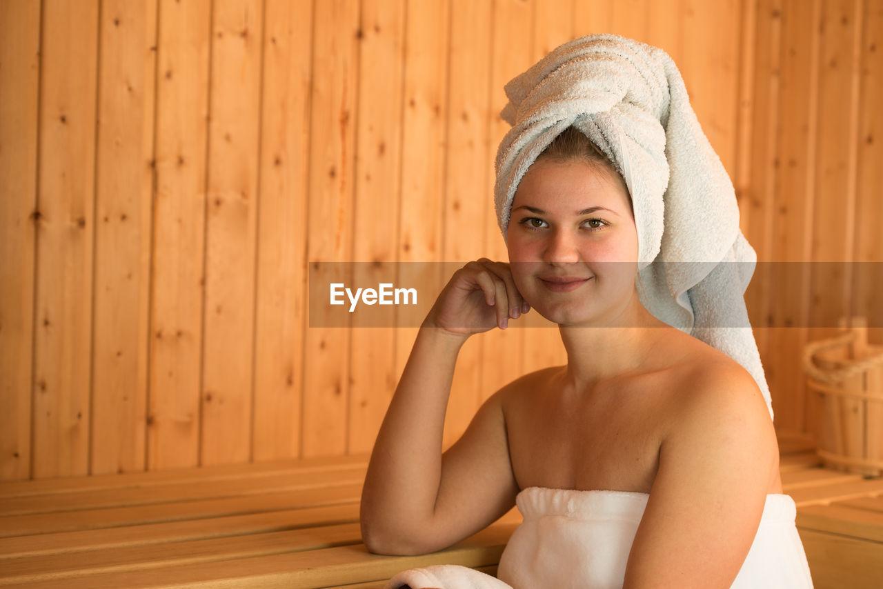 Beautiful Young Woman Relaxing In Sauna
