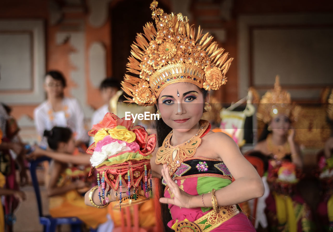 Portrait Of Young Woman In Costume Dancing During Celebration