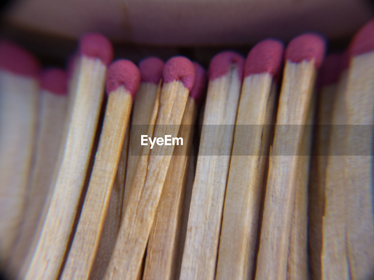 close-up, wood - material, large group of objects, indoors, no people, matchstick, still life, selective focus, focus on foreground, flame, arrangement, pattern, in a row, side by side, abundance, high angle view, pencil
