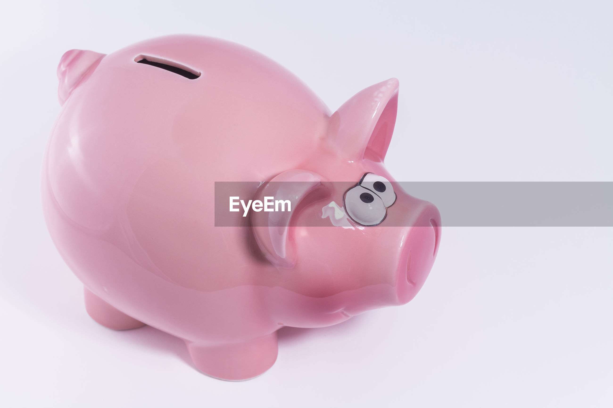 Close-up of piggy bank on white background
