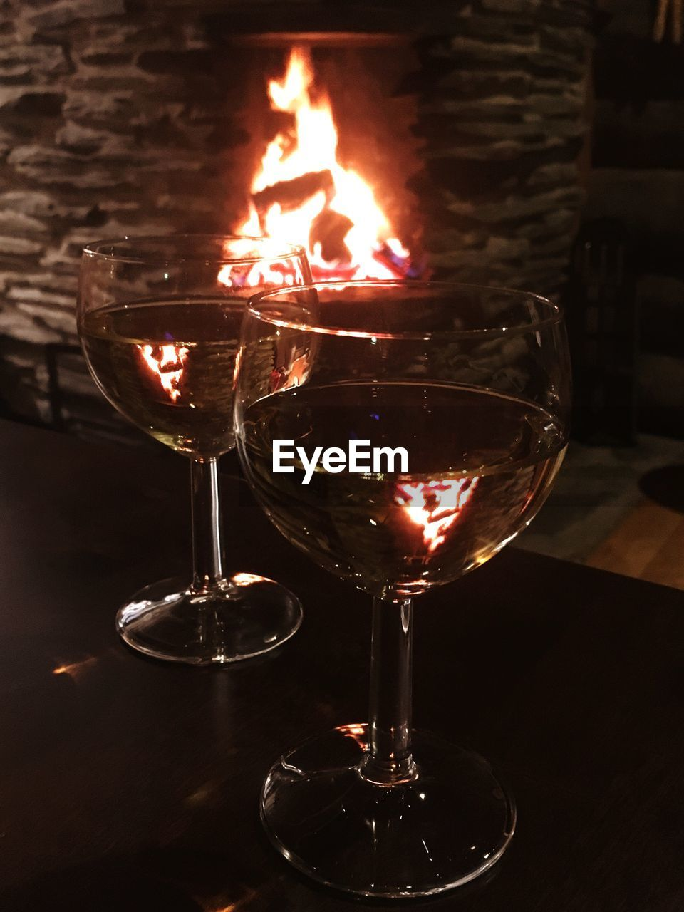 flame, burning, wineglass, wine, heat - temperature, alcohol, no people, indoors, red wine, table, drink, refreshment, close-up, night, illuminated