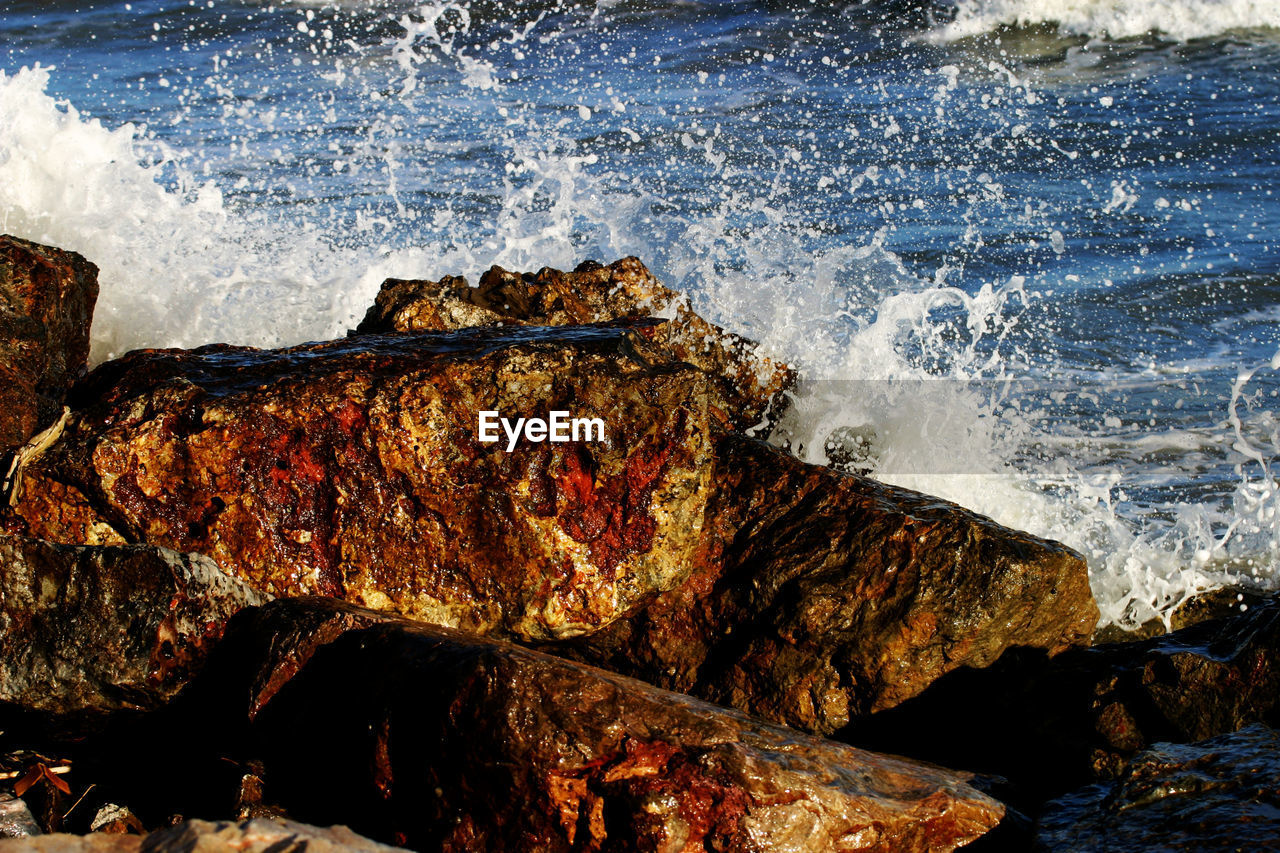 sea, water, rock, rock - object, motion, solid, no people, wave, splashing, rock formation, nature, power, sport, beauty in nature, day, power in nature, rough, land, outdoors, breaking, hitting, rocky coastline
