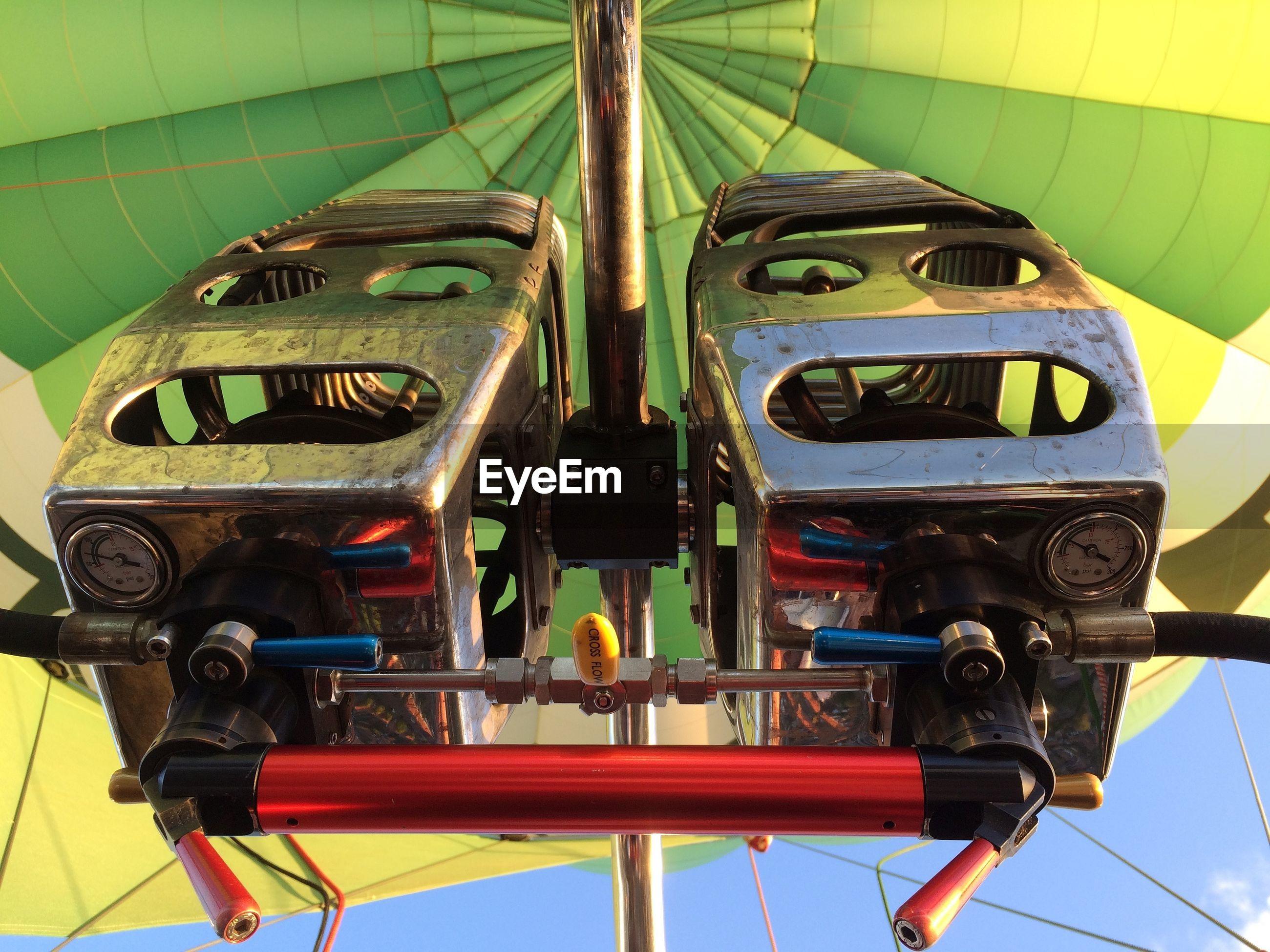 Close-up of hot air balloon machine against sky