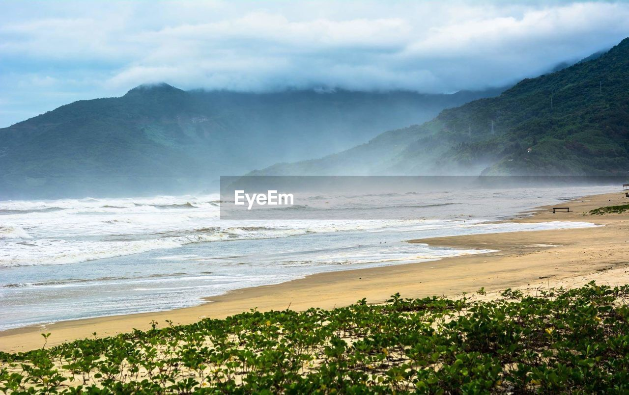 nature, sea, beauty in nature, beach, scenics, water, tranquility, tranquil scene, sky, no people, outdoors, day, sand, wave, landscape, mountain, tree