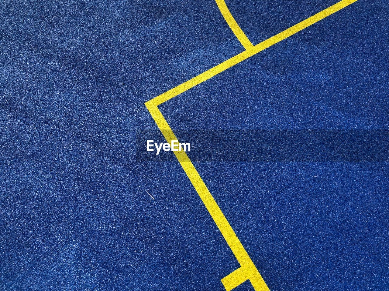yellow, road, sign, blue, day, asphalt, symbol, no people, high angle view, transportation, road marking, marking, full frame, textured, single line, dividing line, backgrounds, pattern, outdoors, direction