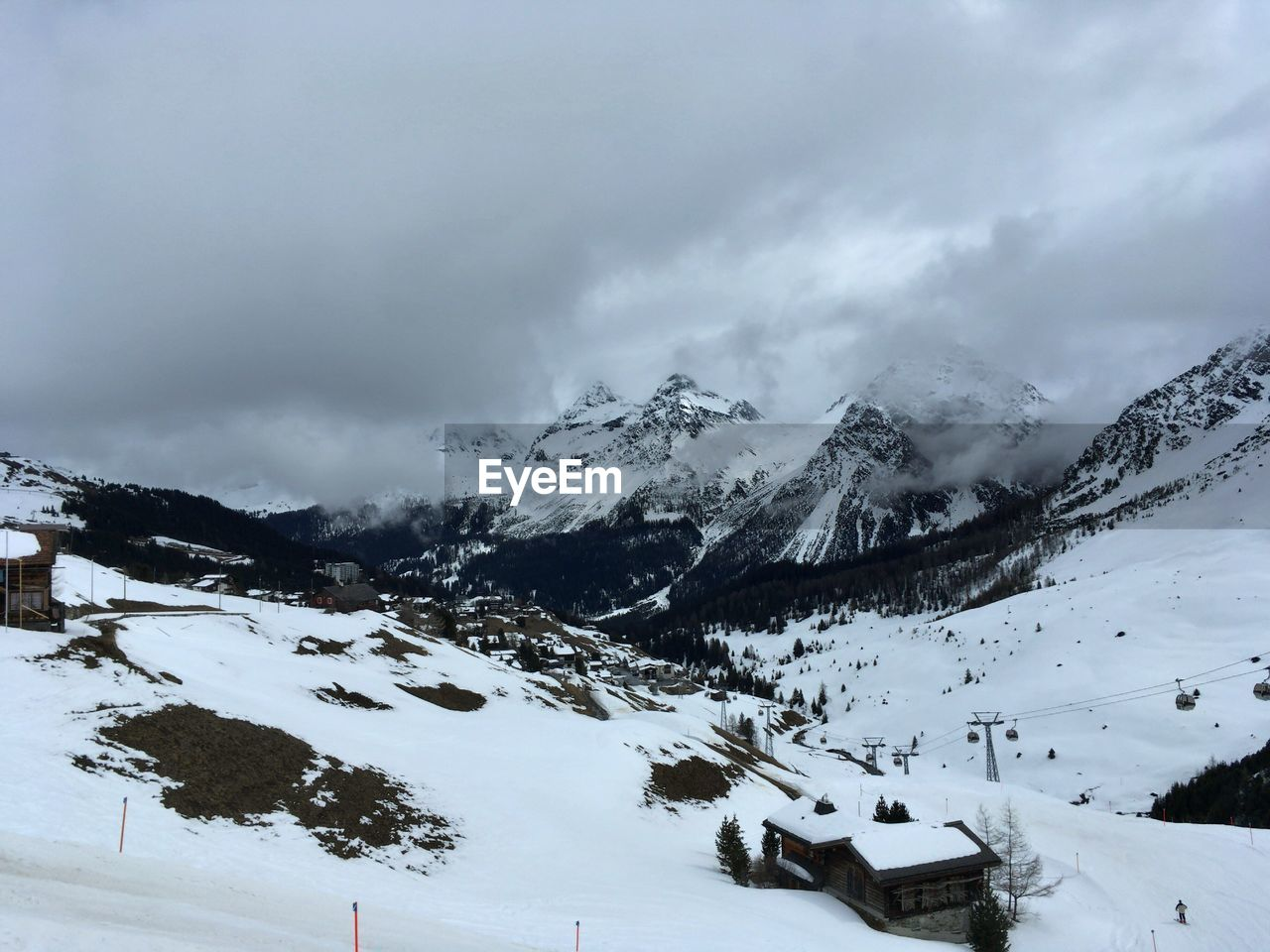 snow, winter, cold temperature, weather, mountain, scenics, nature, landscape, beauty in nature, tranquil scene, tranquility, snowcapped mountain, outdoors, sky, cloud - sky, skiing, mountain range, day, no people, wilderness area, ski lift, range