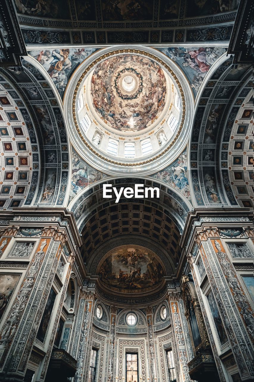 architecture, built structure, ceiling, building exterior, building, low angle view, place of worship, religion, dome, spirituality, no people, belief, travel destinations, day, history, cupola, arch, mural, fresco, ornate, directly below, architectural column, gothic style