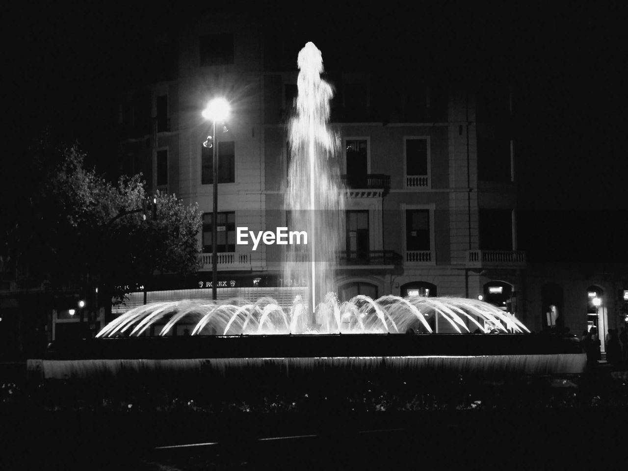 night, illuminated, long exposure, motion, blurred motion, no people, statue, outdoors, architecture, building exterior, sculpture, spraying