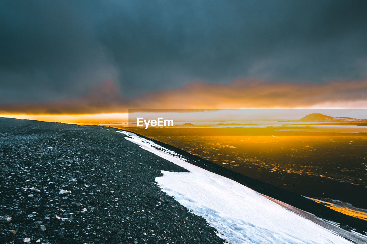 sunset, sky, scenics - nature, beauty in nature, cloud - sky, winter, cold temperature, tranquil scene, nature, tranquility, snow, idyllic, no people, orange color, non-urban scene, environment, mountain, landscape, remote, outdoors