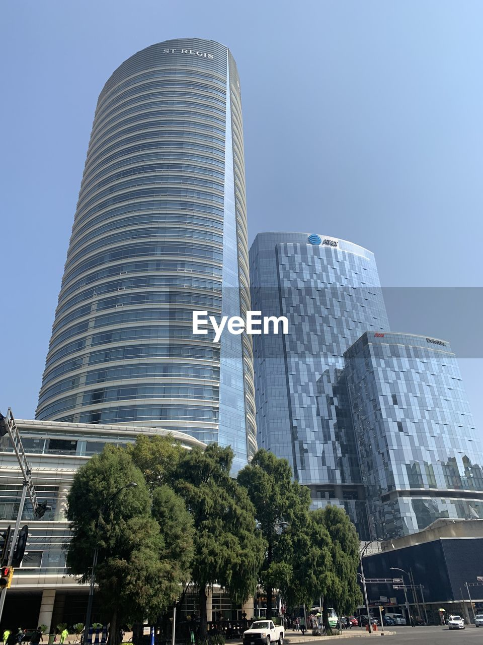 built structure, architecture, building exterior, city, sky, modern, building, office building exterior, tree, plant, nature, tall - high, skyscraper, low angle view, office, day, clear sky, incidental people, travel destinations, transportation, outdoors, luxury
