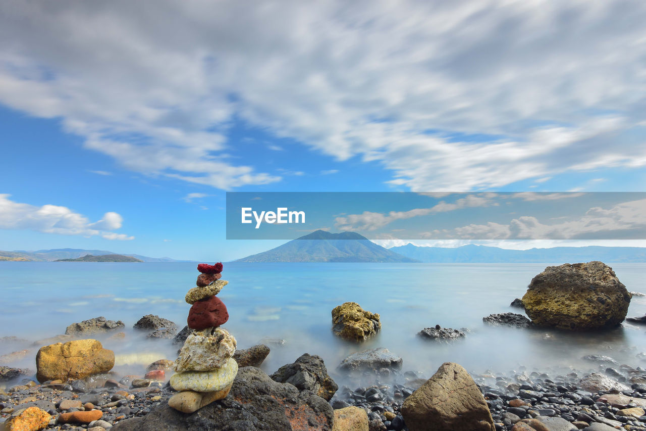 sky, cloud - sky, rock, solid, water, sea, rock - object, beauty in nature, scenics - nature, tranquility, tranquil scene, nature, day, land, no people, non-urban scene, idyllic, beach, remote, outdoors, pebble