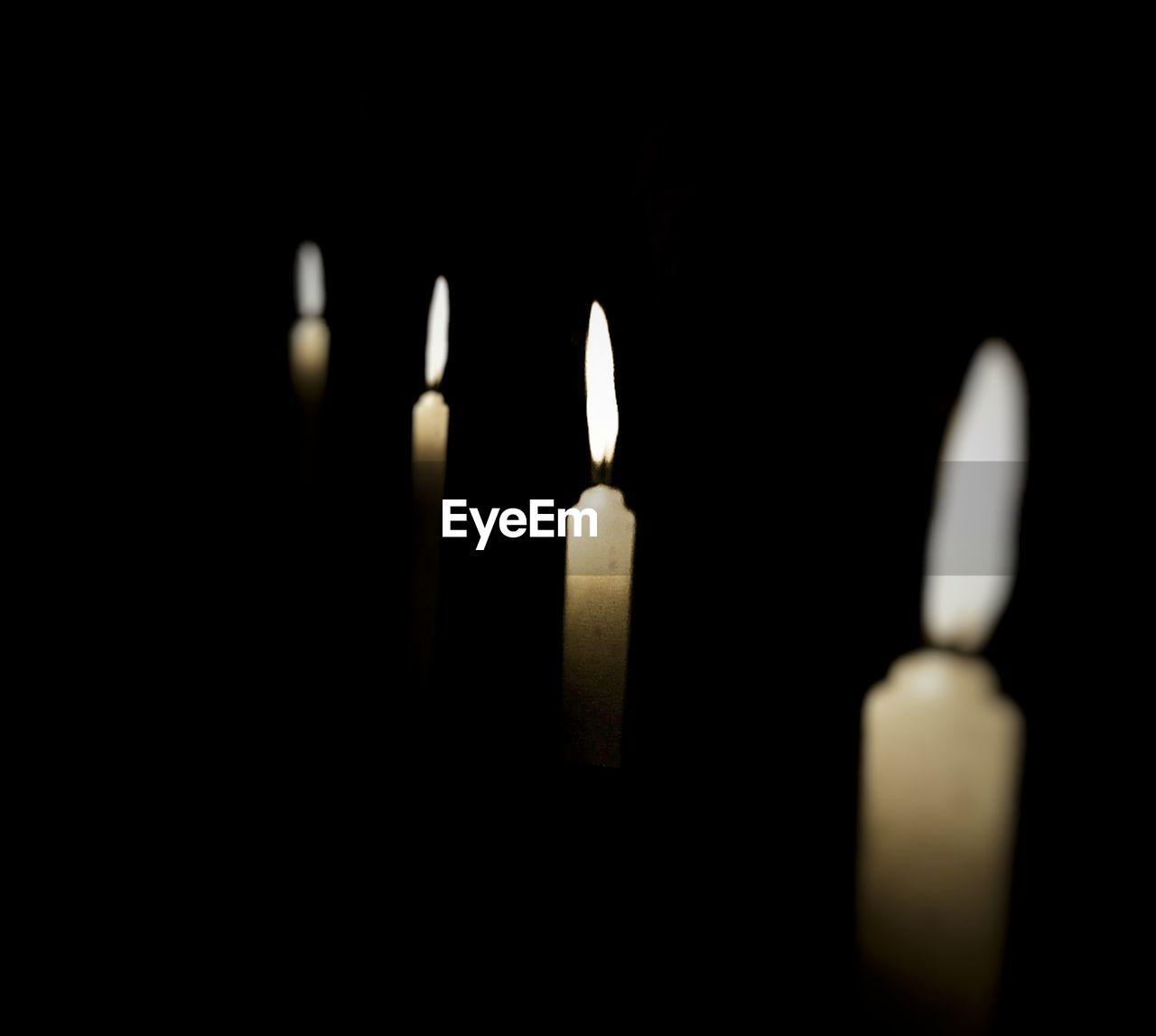 candle, flame, spirituality, burning, religion, black background, close-up, illuminated, no people, studio shot, indoors