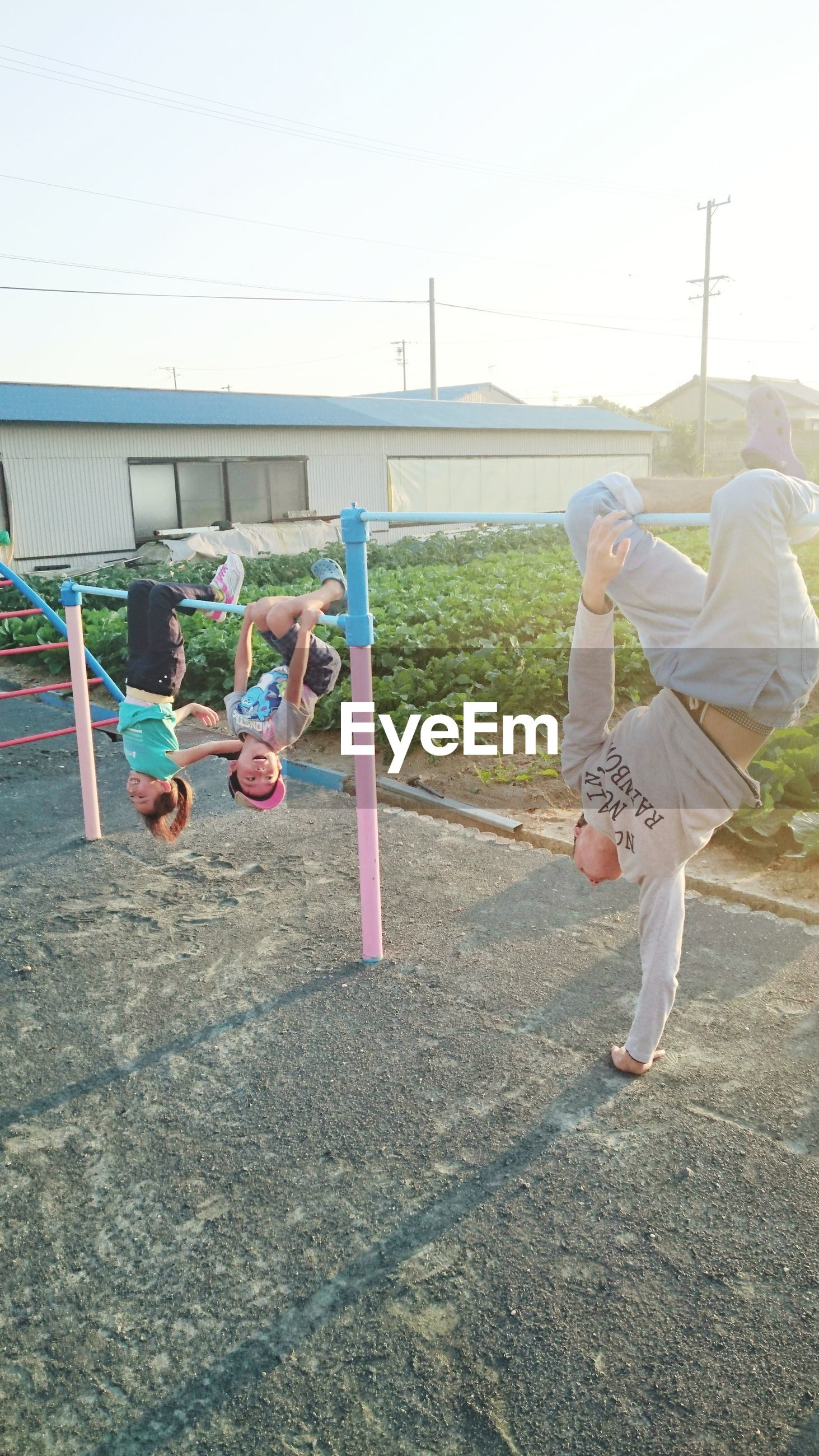 full length, lifestyles, leisure activity, real people, girls, females, men, day, women, childhood, child, group of people, people, exercising, nature, enjoyment, togetherness, sky, playground, outdoors