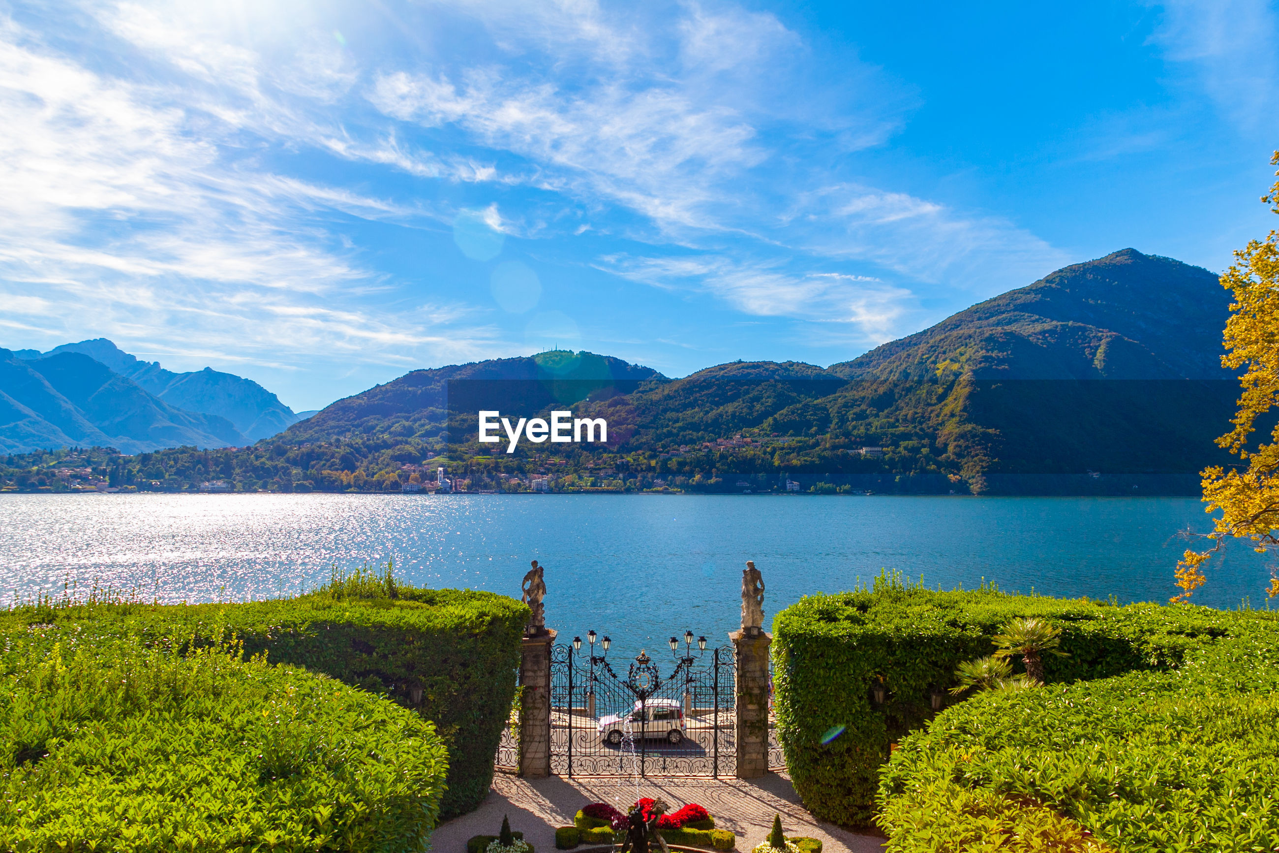 The fountain in the garden of villa carlotta, lombardy, italy, on lake como, mountains on background