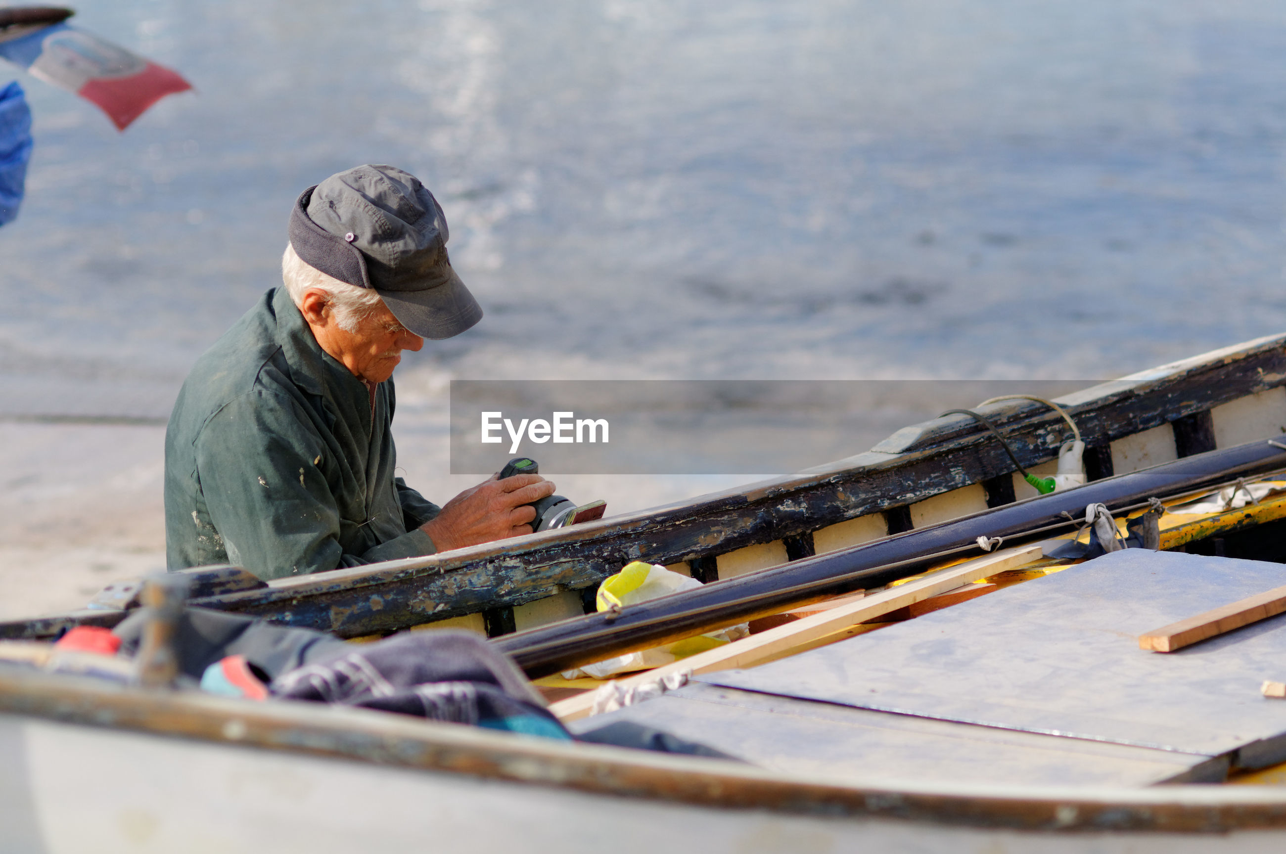 MAN WORKING ON BOAT