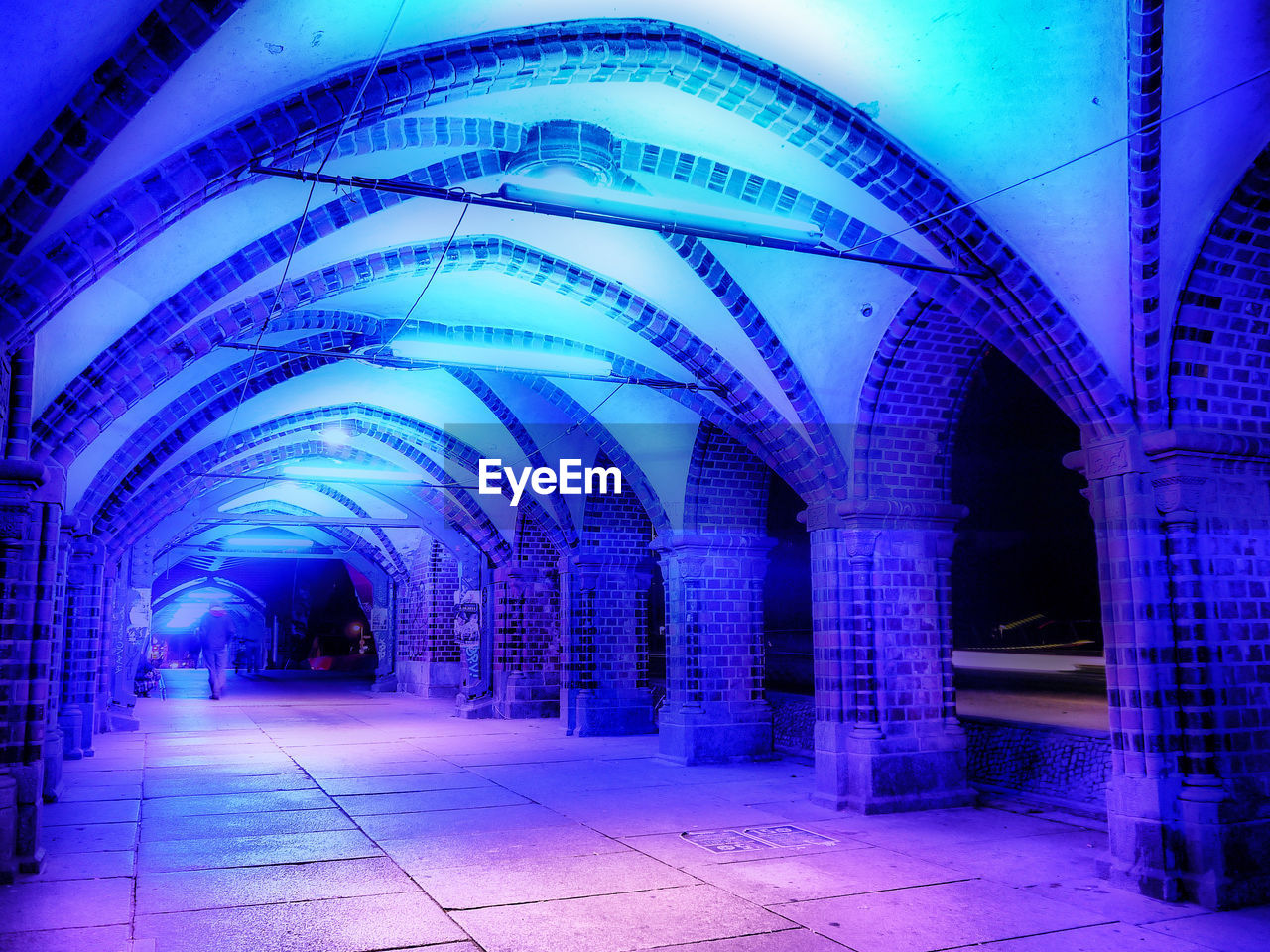 architecture, arch, built structure, illuminated, indoors, no people, night, blue, architectural column, the way forward, direction, lighting equipment, building, in a row, blurred motion, footpath, glowing, light - natural phenomenon, empty, ceiling