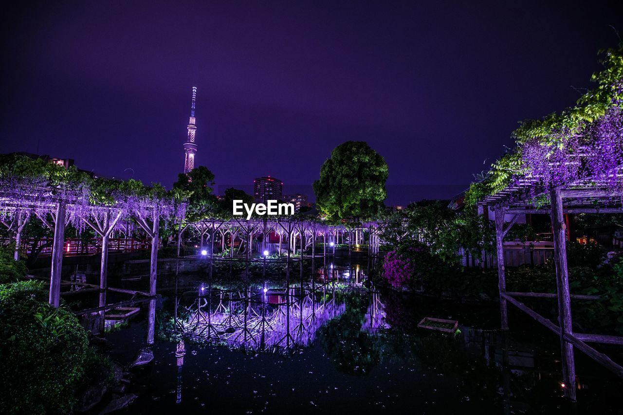 night, built structure, illuminated, sky, architecture, water, tree, building exterior, reflection, plant, nature, no people, river, city, building, waterfront, tower, dusk, outdoors, purple