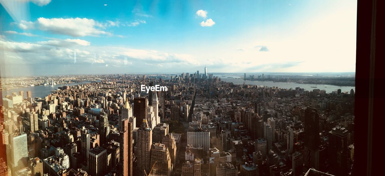 city, sky, cityscape, building exterior, architecture, built structure, cloud - sky, building, nature, crowd, aerial view, skyscraper, high angle view, crowded, residential district, day, travel destinations, office building exterior, tourism, modern, outdoors, financial district