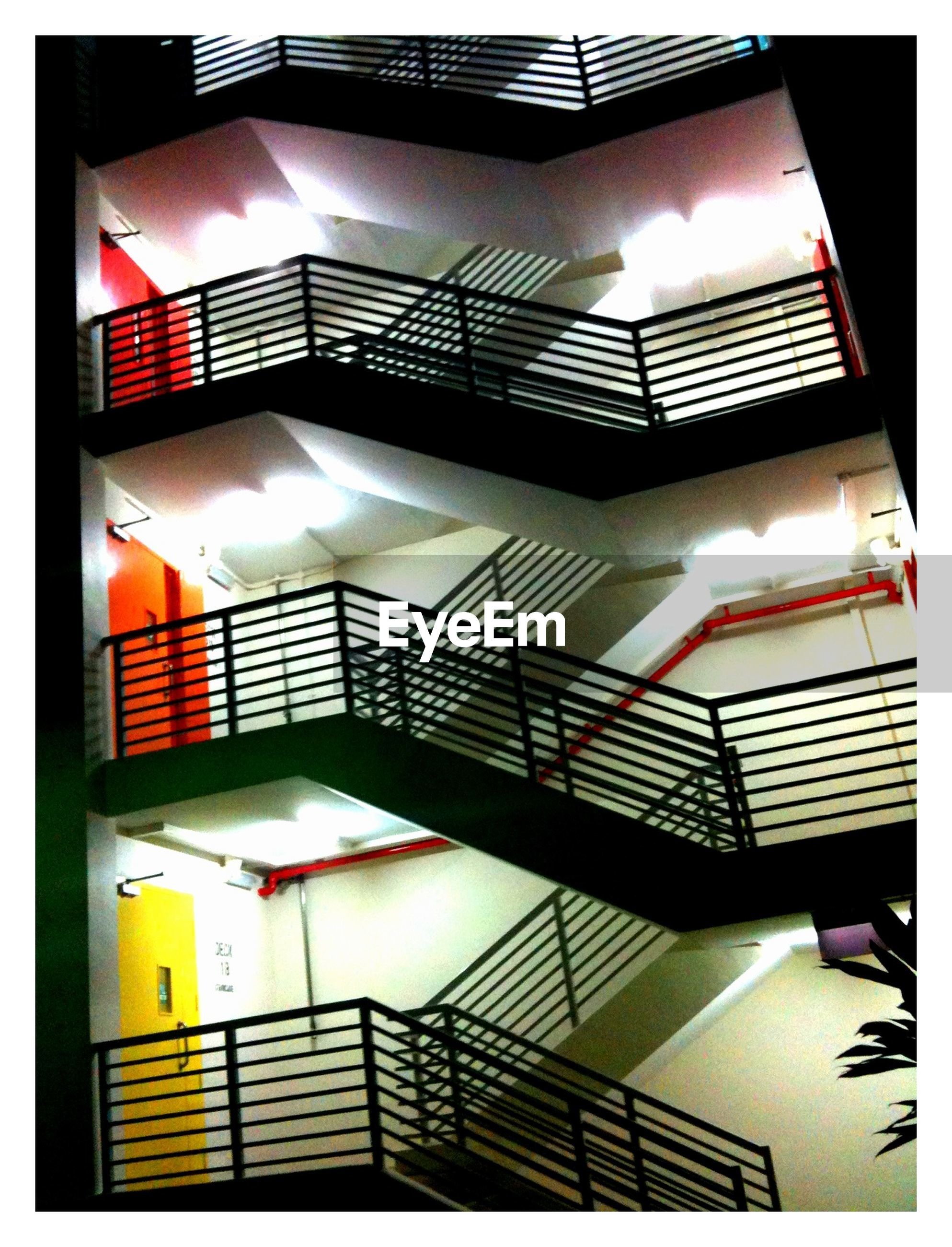 transfer print, auto post production filter, indoors, steps, staircase, railing, steps and staircases, architecture, built structure, sunlight, stairs, low angle view, high angle view, no people, escalator, absence, day, building, reflection, building exterior