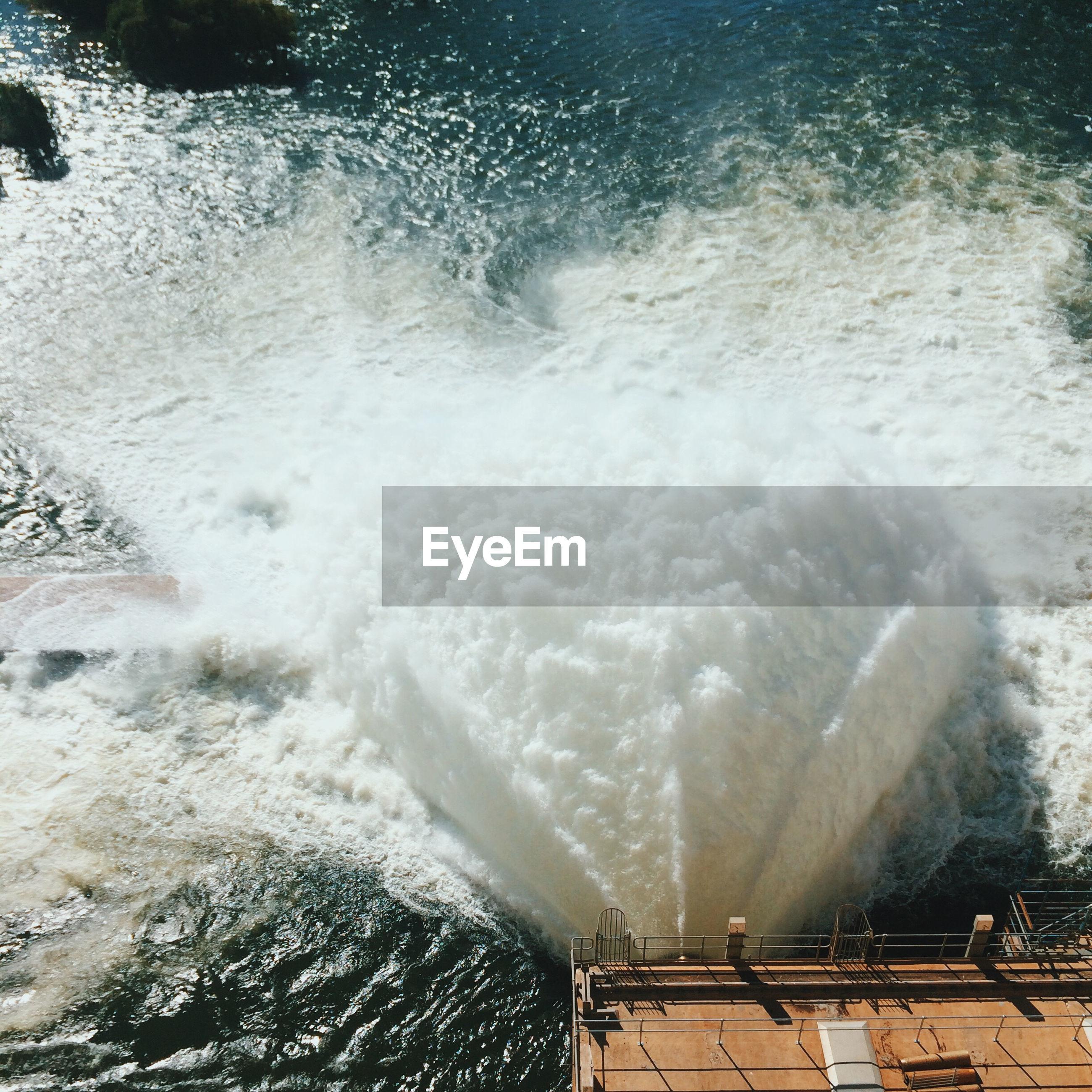Waves hitting pier