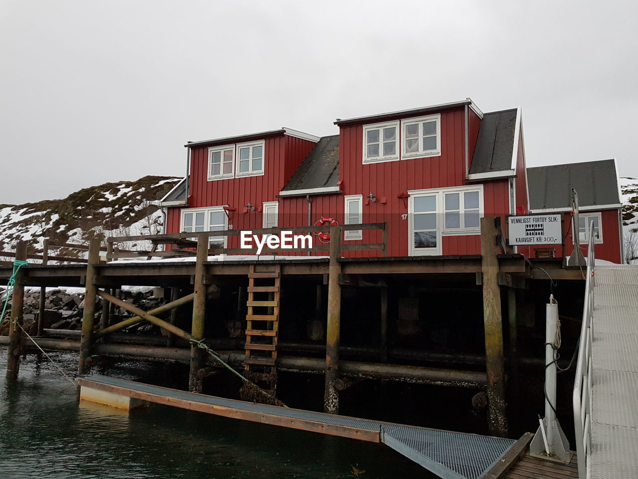 built structure, sky, water, architecture, building exterior, no people, nature, building, house, red, wood - material, day, lake, outdoors, residential district, nautical vessel, transportation, stilt house