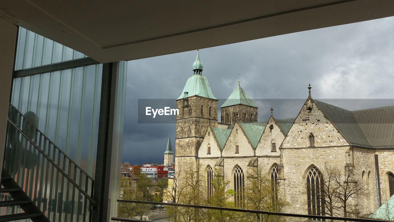 Old Church Against Cloudy Sky