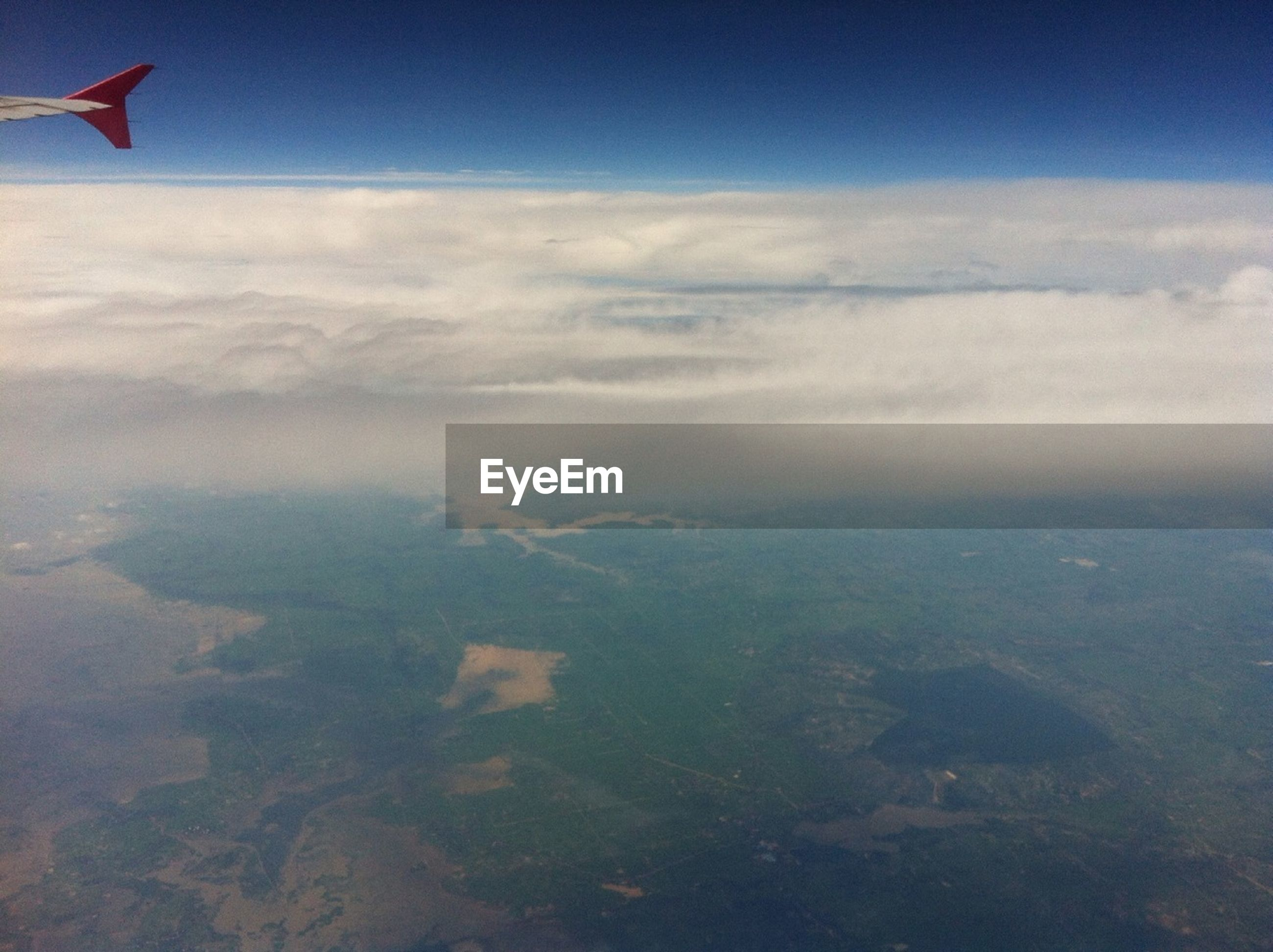 sky, flying, cloud - sky, scenics, beauty in nature, tranquility, tranquil scene, nature, cloud, mid-air, landscape, cloudy, day, idyllic, outdoors, no people, aerial view, airplane, white color, cloudscape
