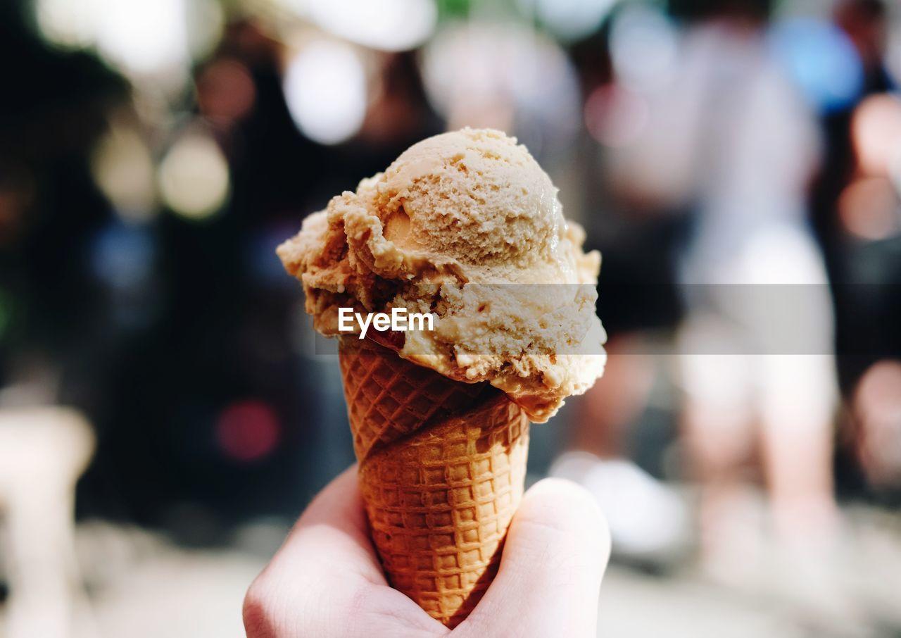 Close-Up Of Hand Holding Ice Cream Cone