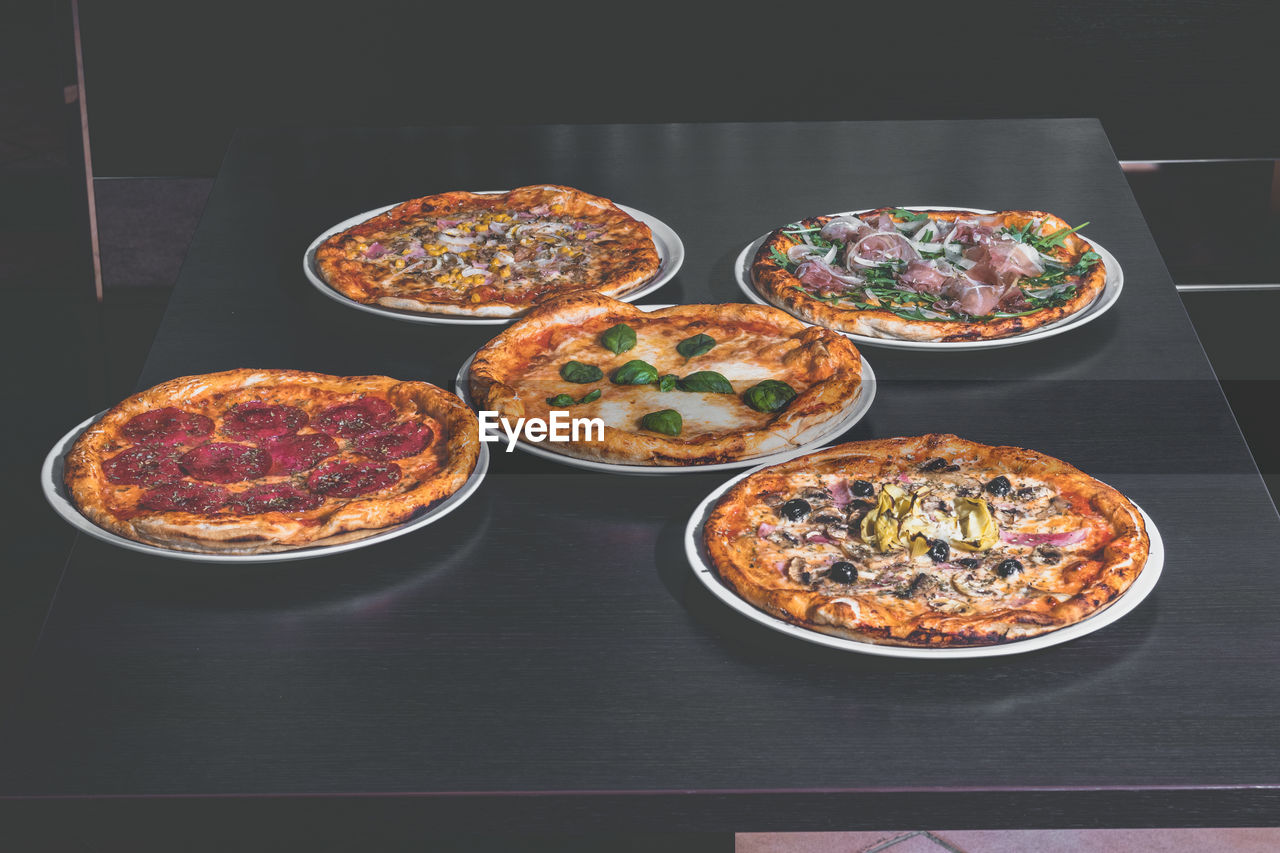pizza, food and drink, food, ready-to-eat, table, indoors, freshness, still life, no people, high angle view, unhealthy eating, plate, indulgence, serving size, variation, bowl, dairy product, italian food, cheese, snack, tray, temptation